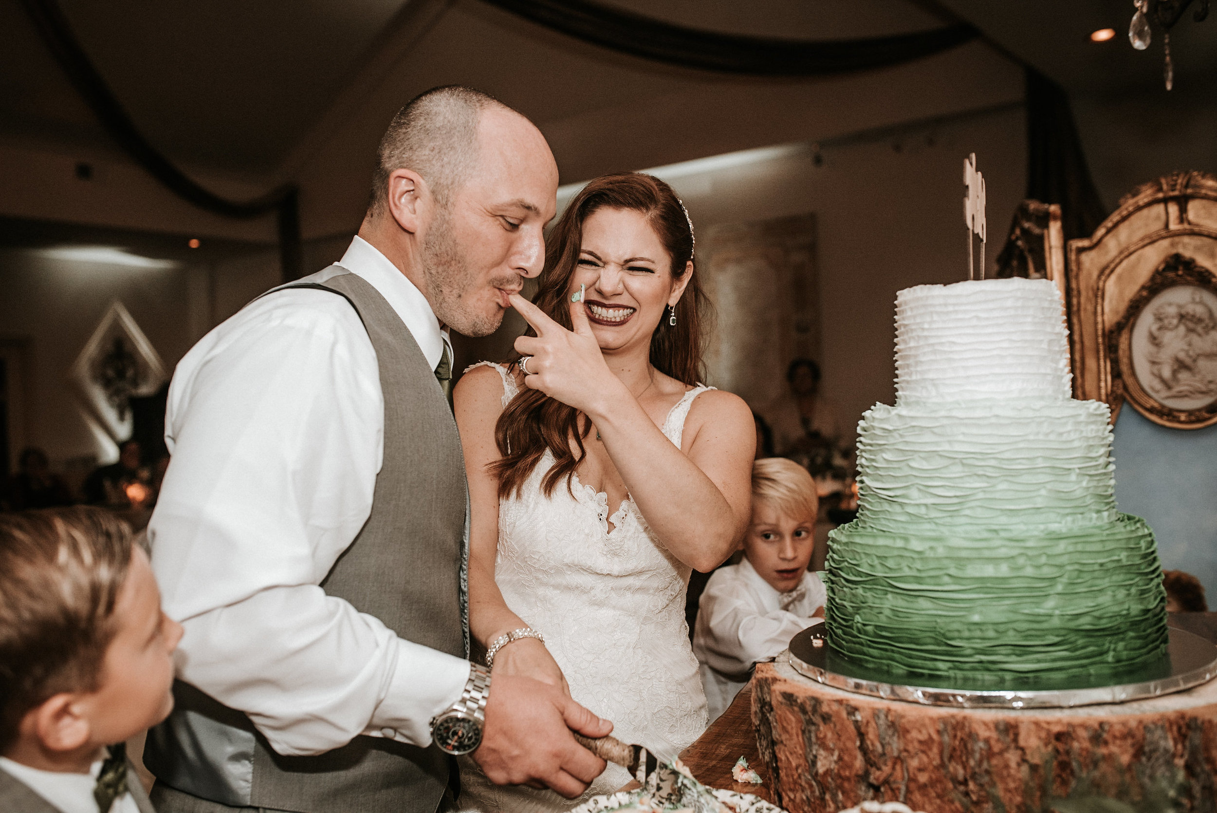 Bride feeding groom cake