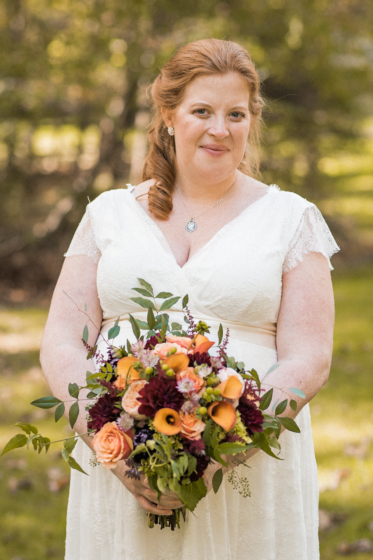 Bride holding fall bouquet