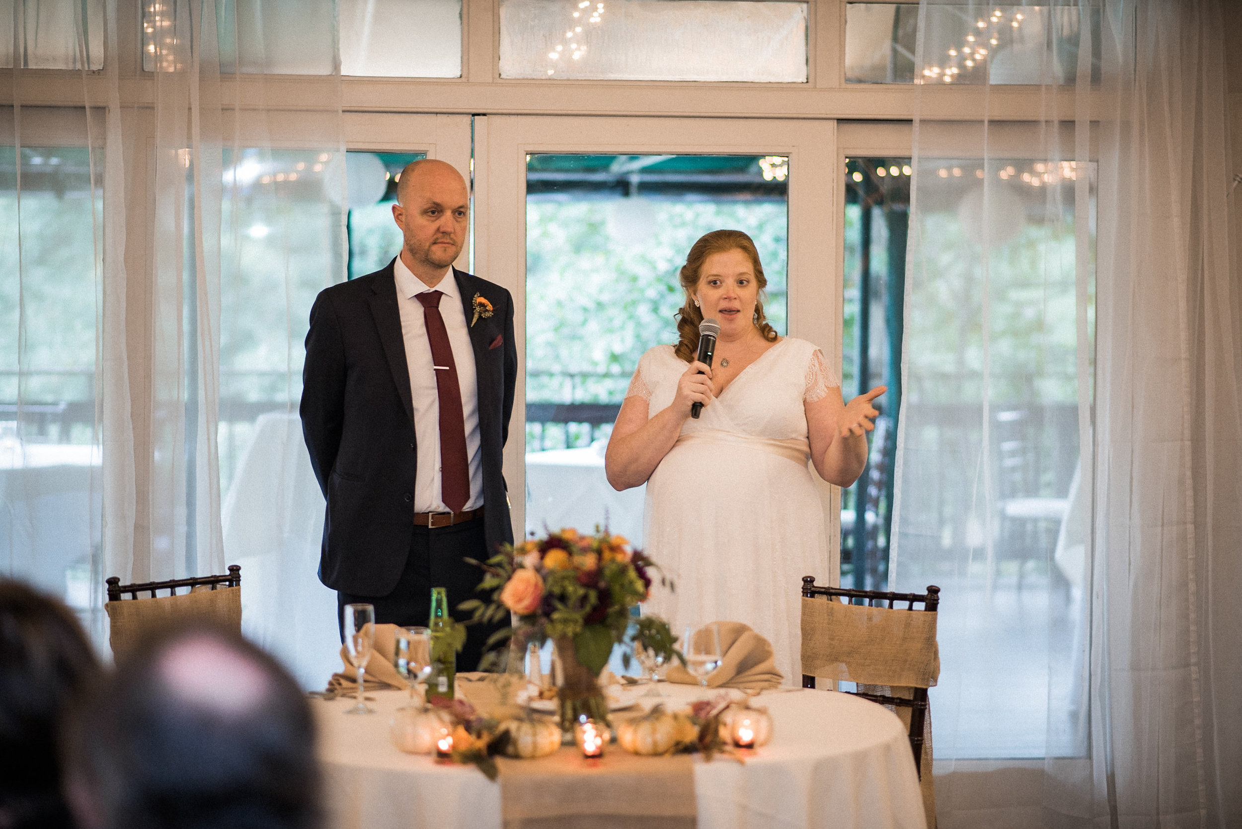 Bride and groom addressing guests