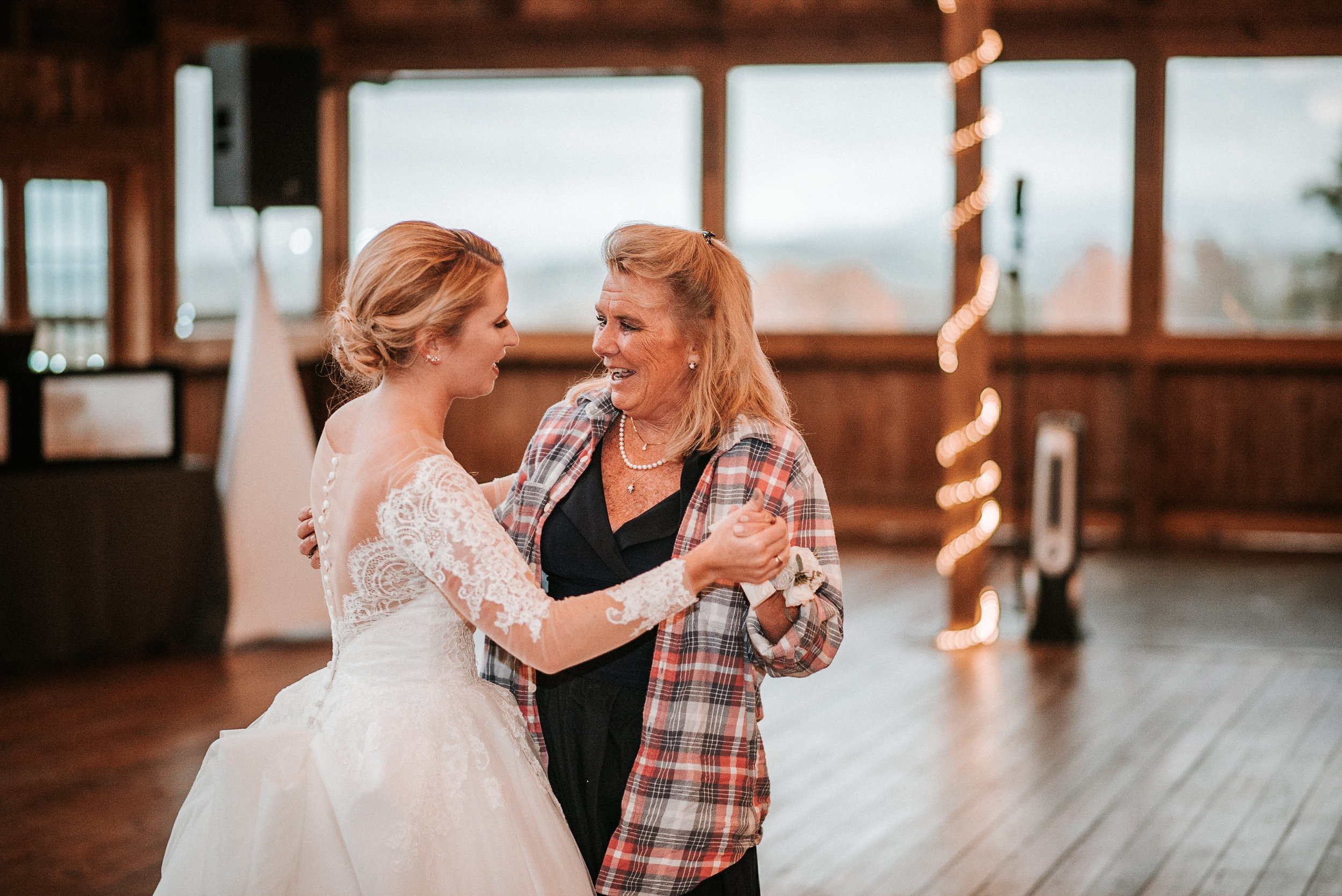 Bride and mother dancing at wedding