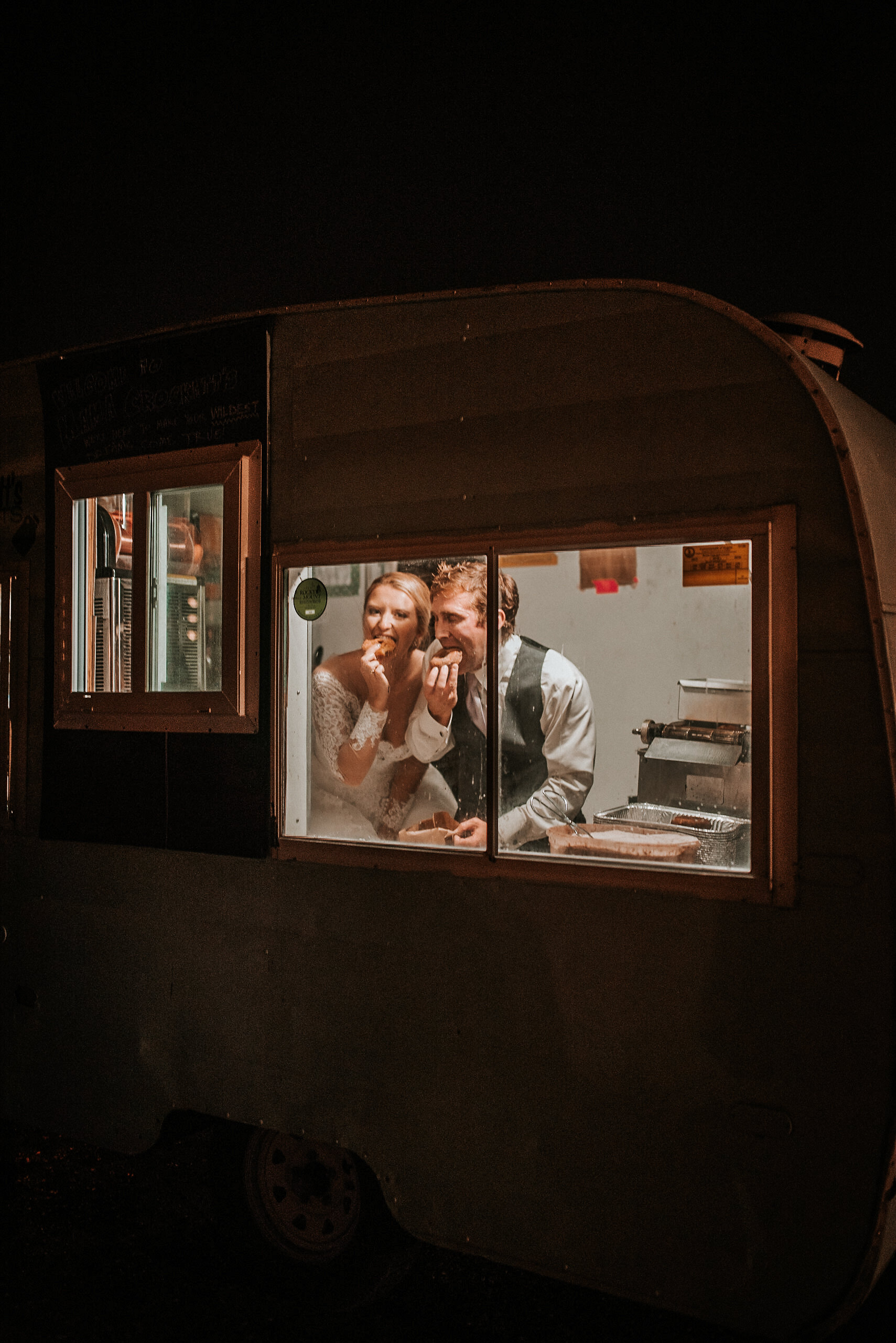 Bride and groom in tiny trailer