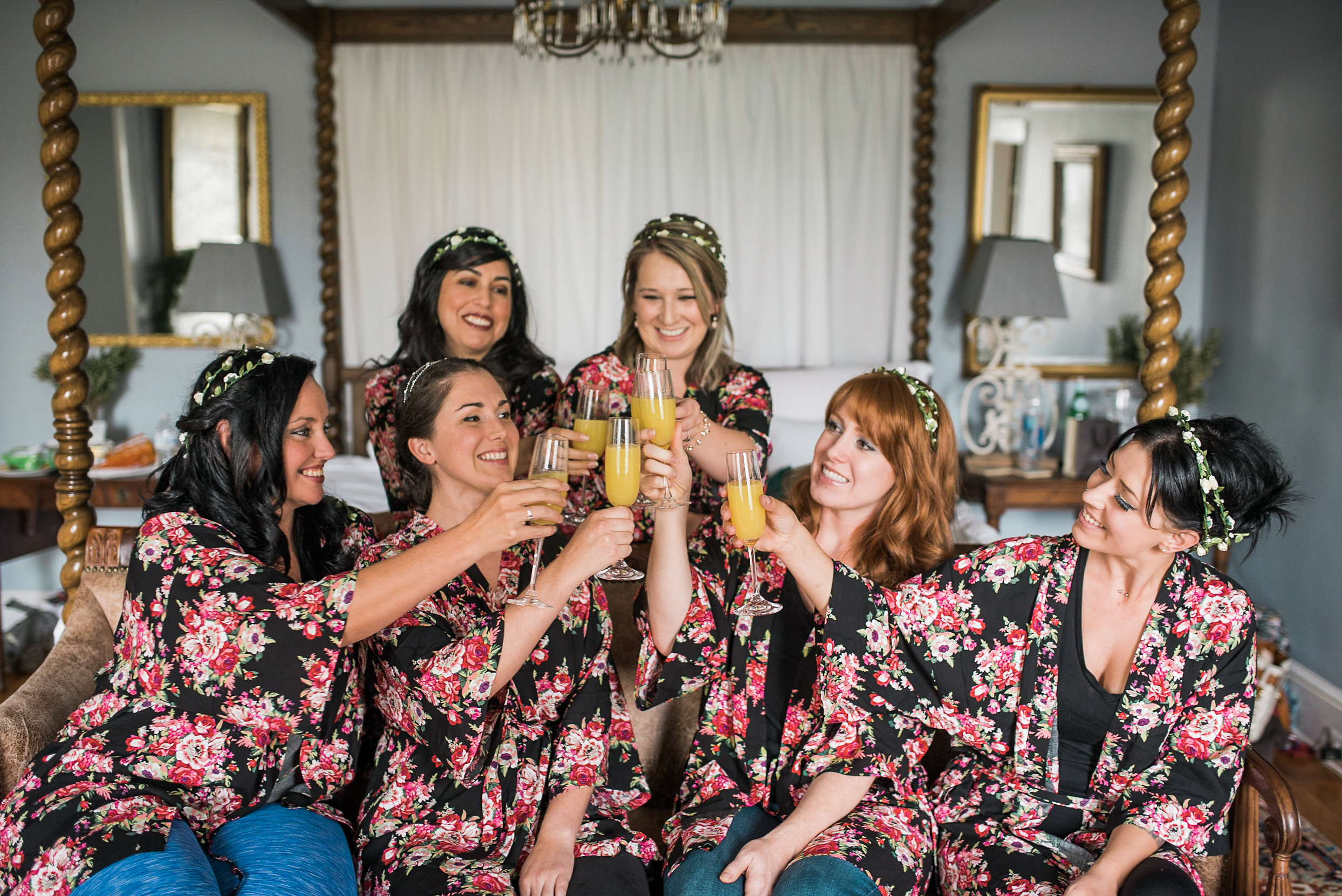 Bride and bridesmaids sharing drink
