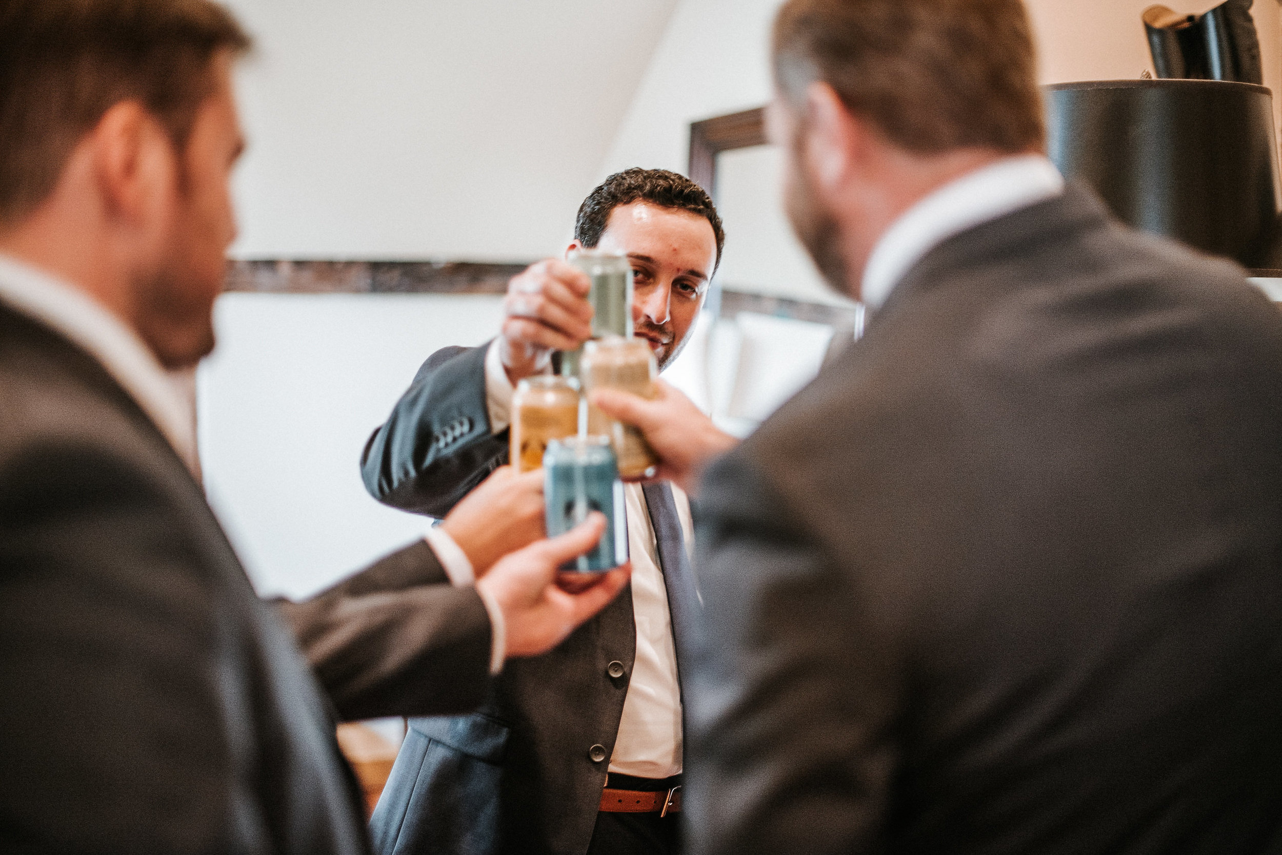 Groomsmen sharing beer