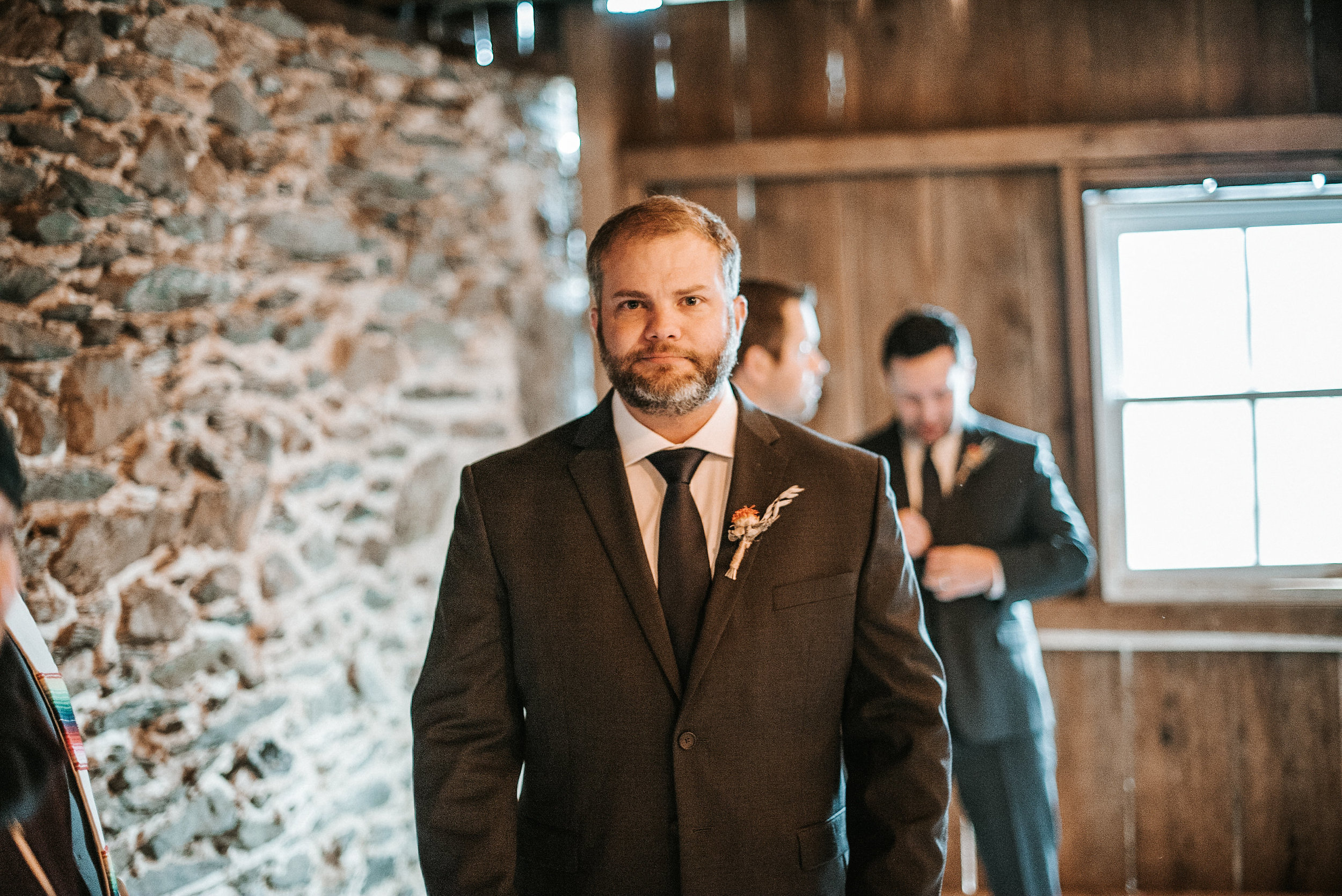 Groom waiting in ceremony space