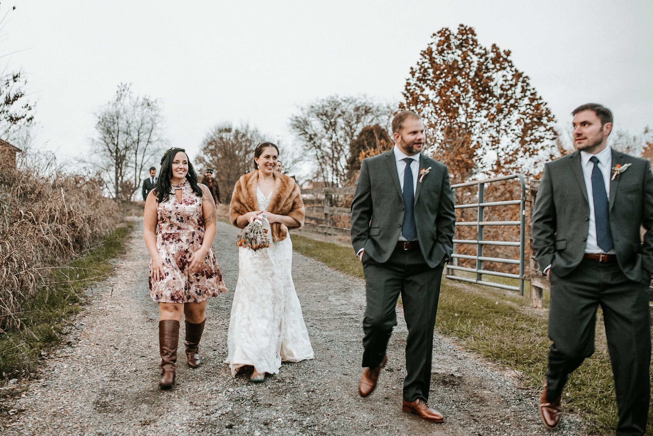Bridal party walking on gravel road