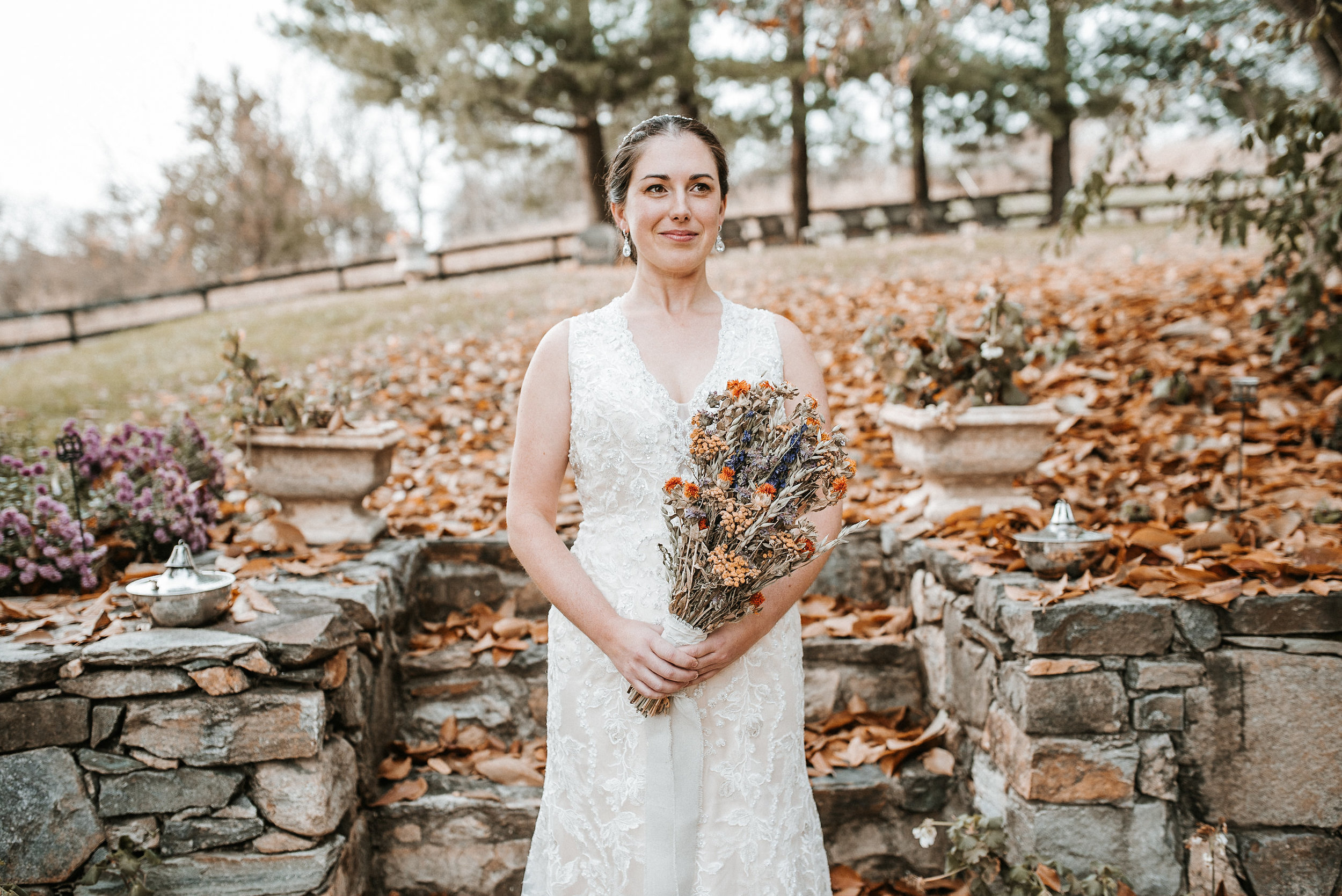 Bride in front of stone steps