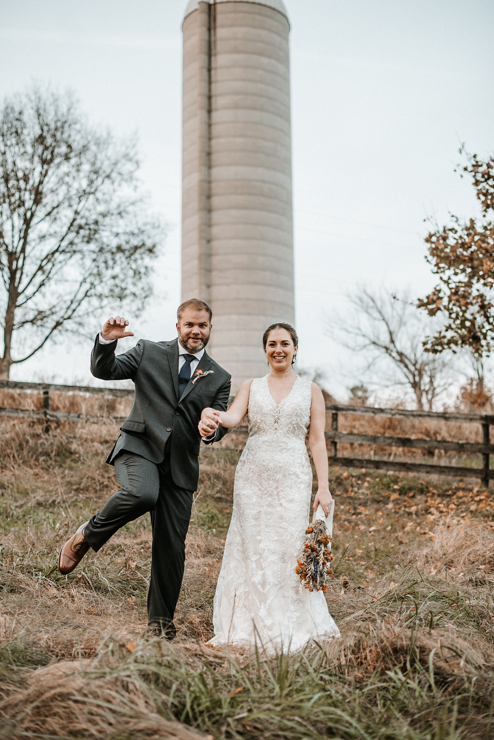 Bride and groom in front of silo