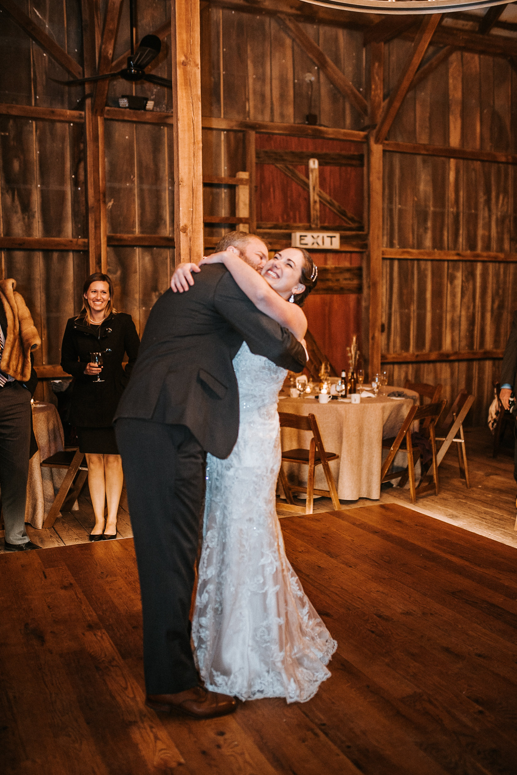 Bride and groom hugging on dance floor
