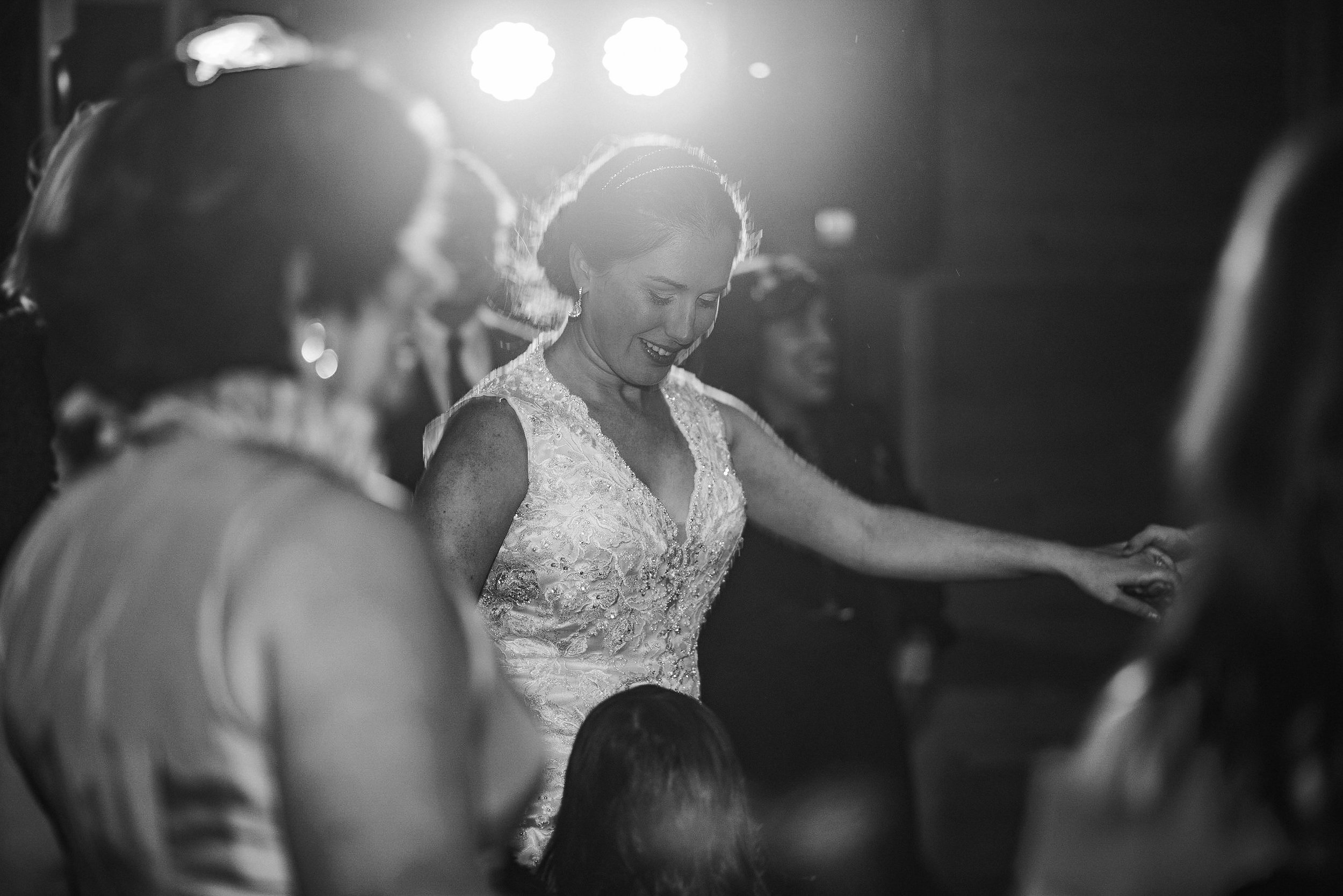 Bride dancing in black and white