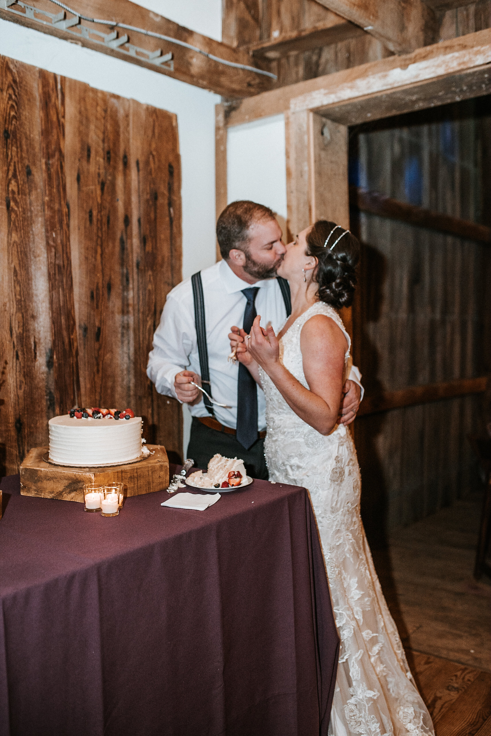 Bride and groom kissing after cake