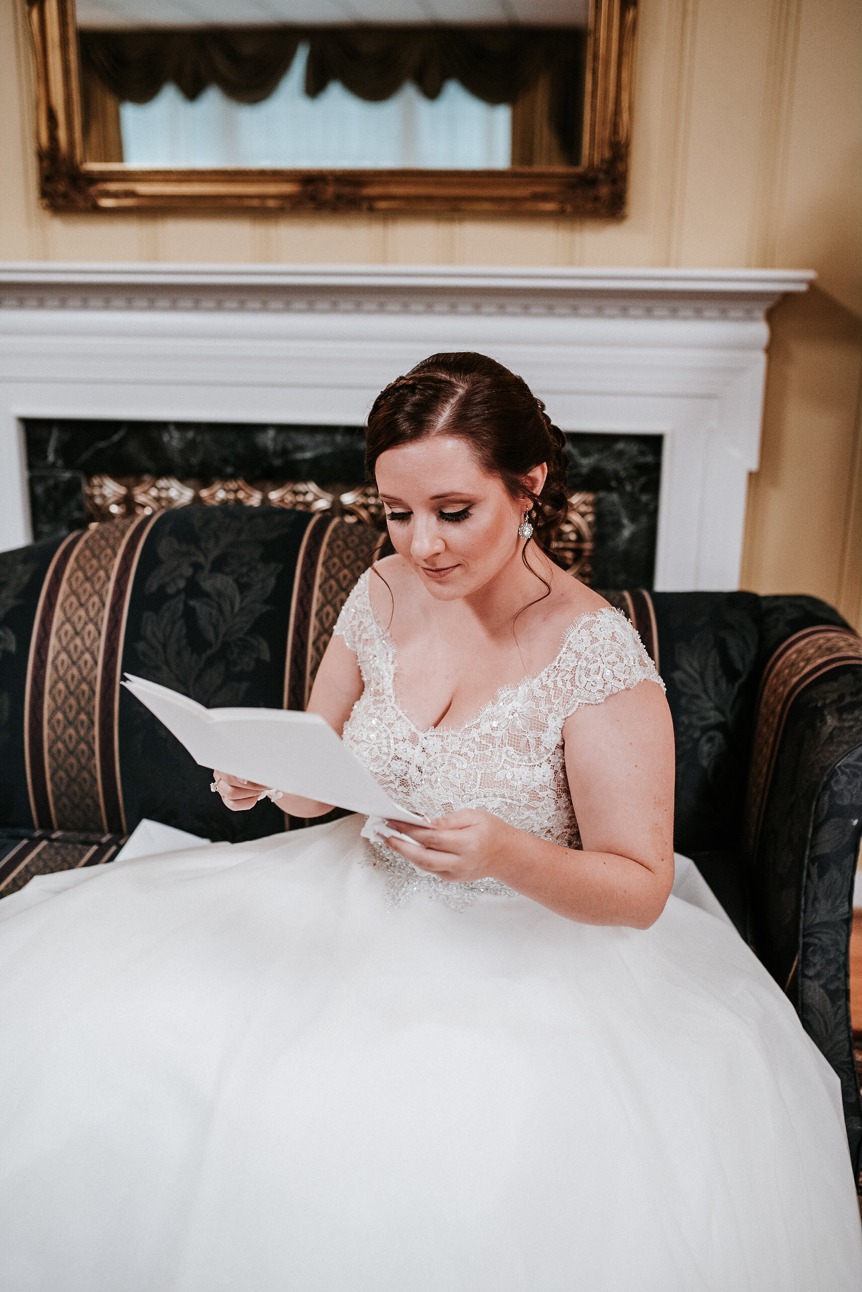 Bride reading letter before wedding