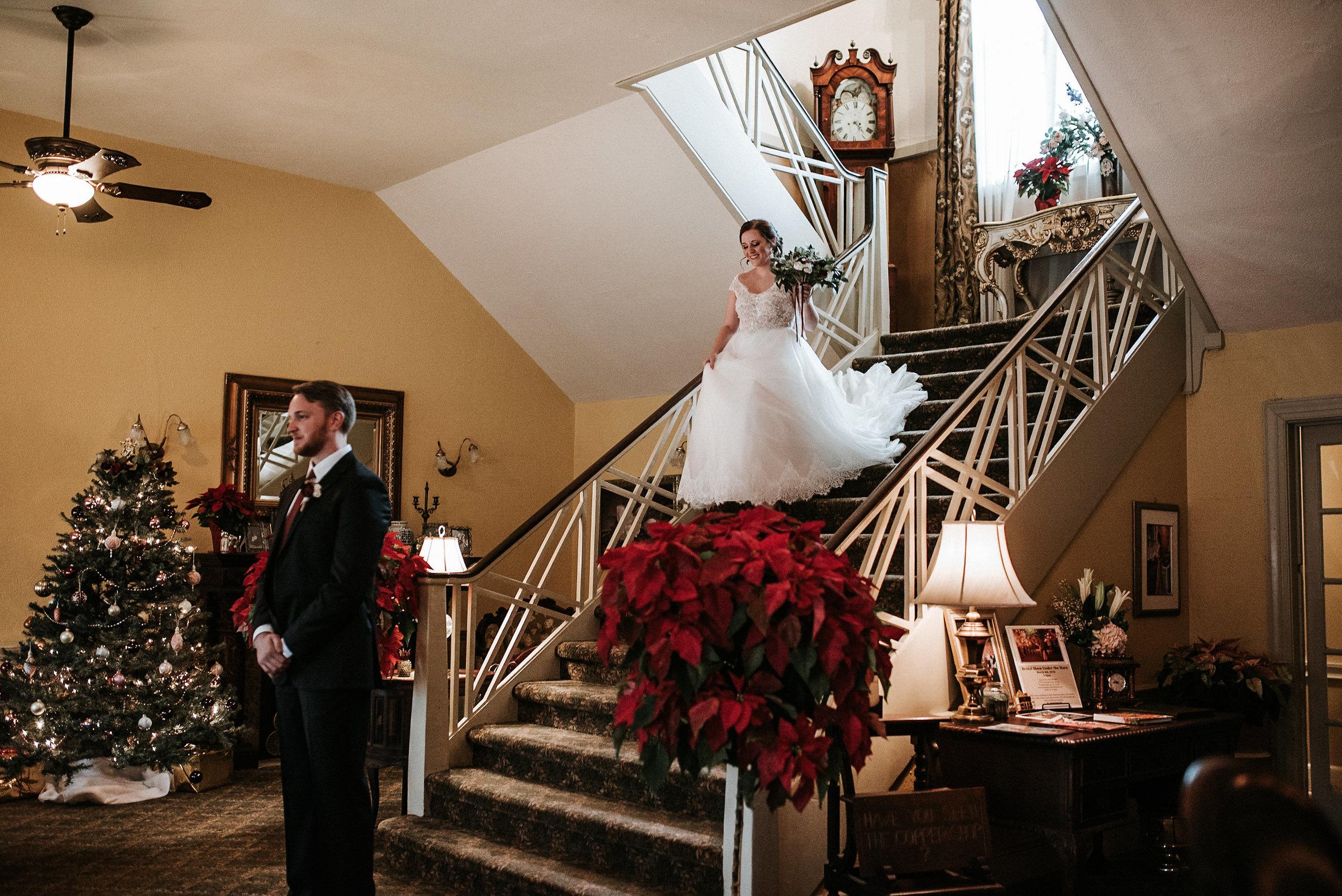 Bride walking downstairs toward groom