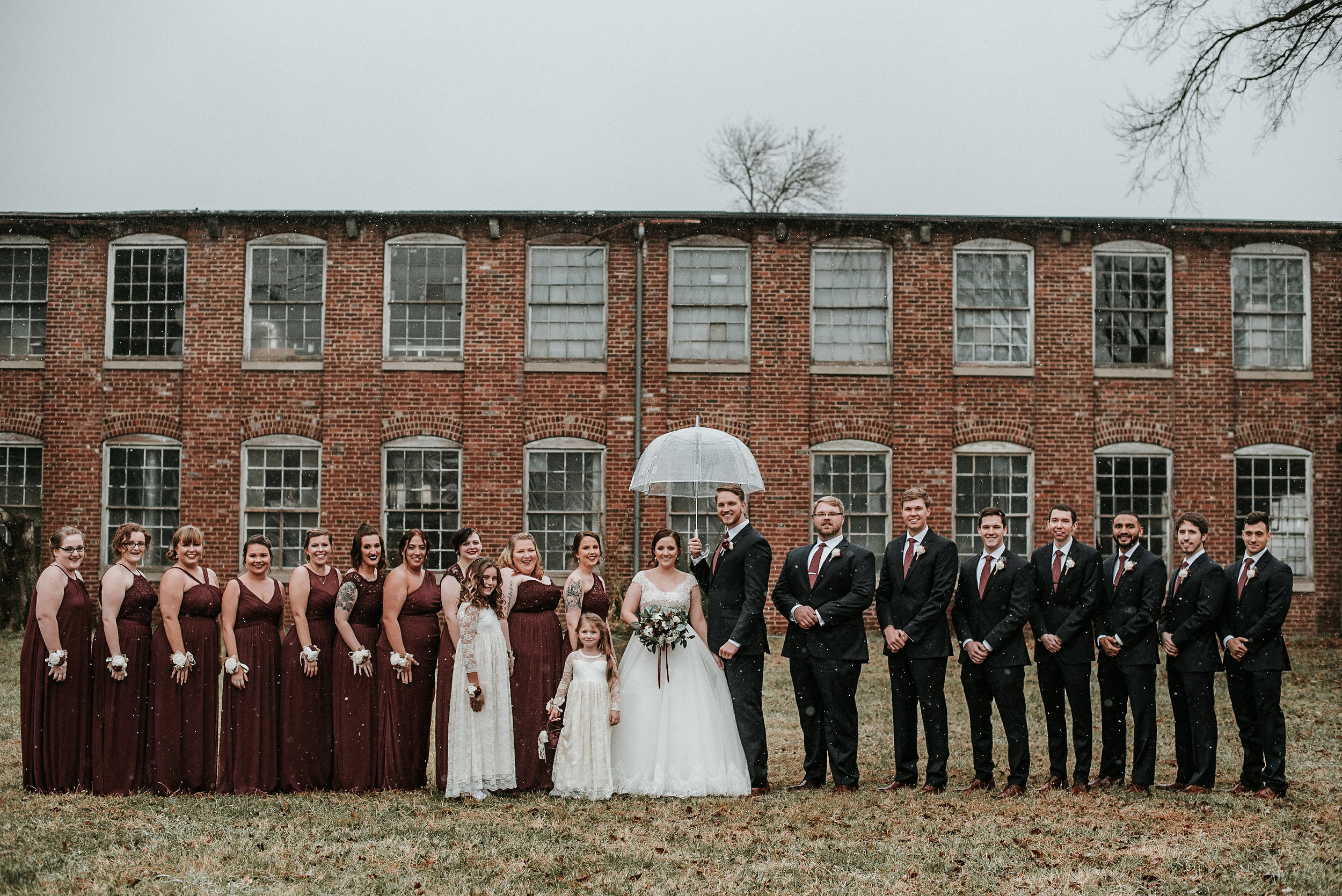 Bridal party in front of old factory