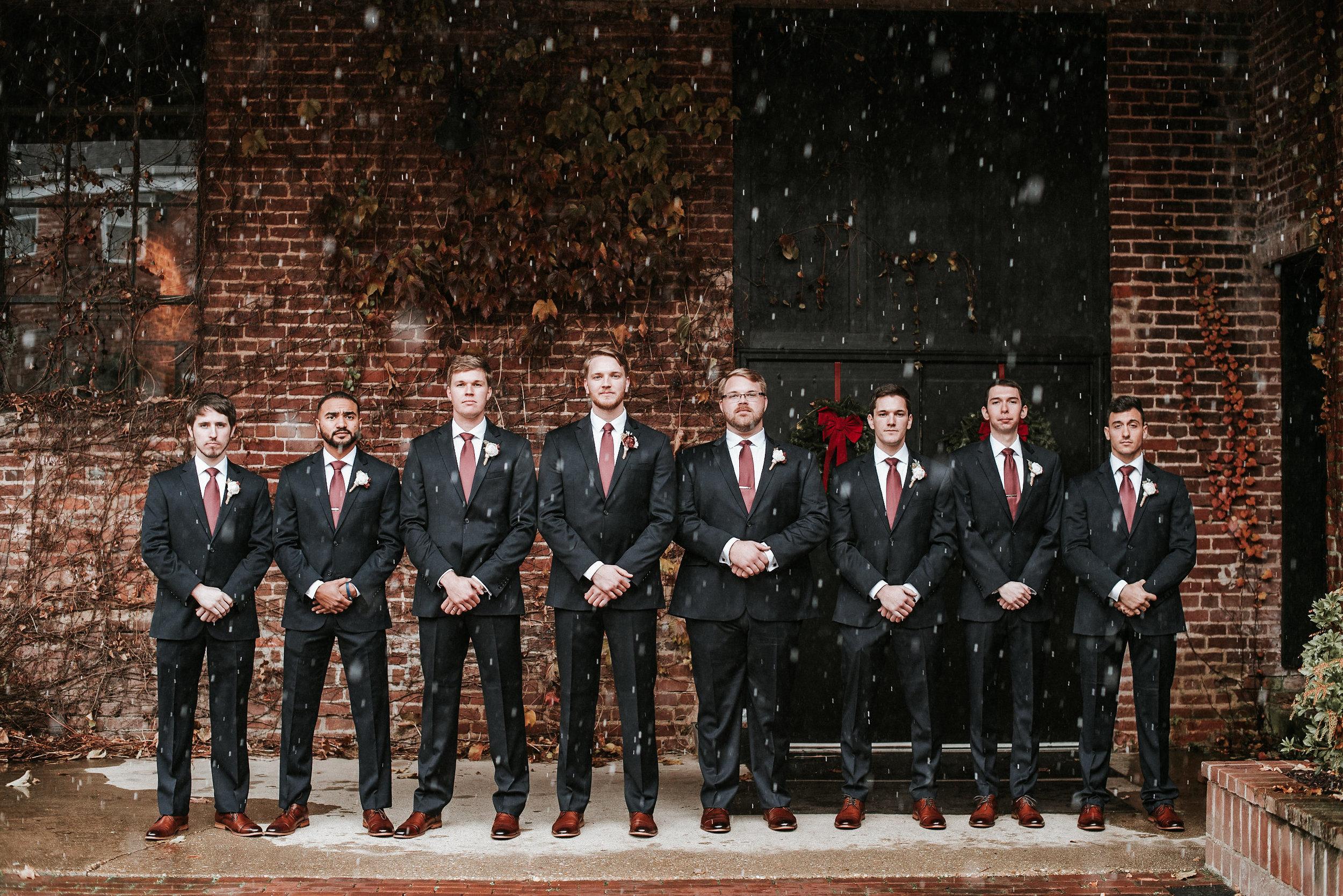Groomsmen in snow