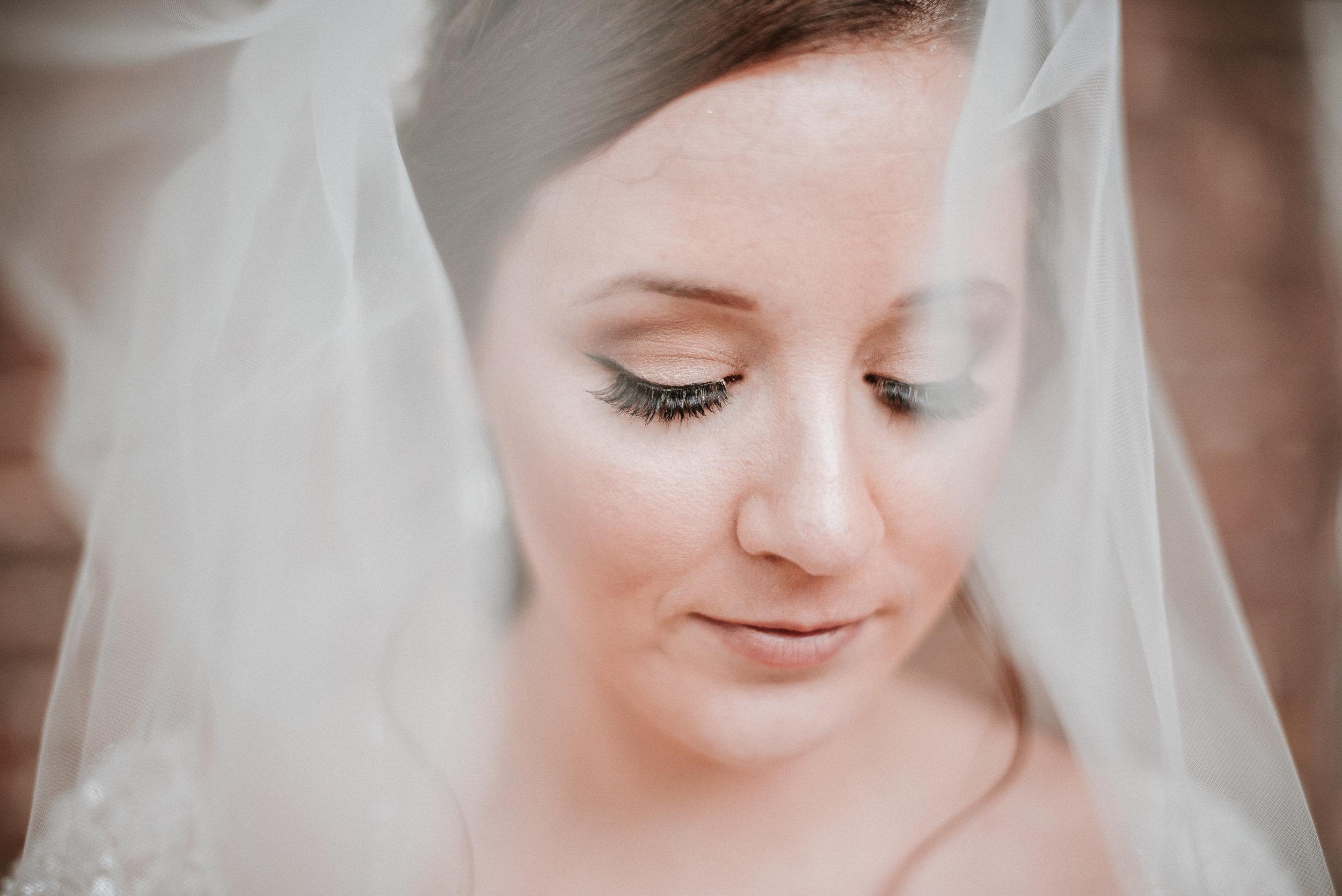 Bride under veil looking down