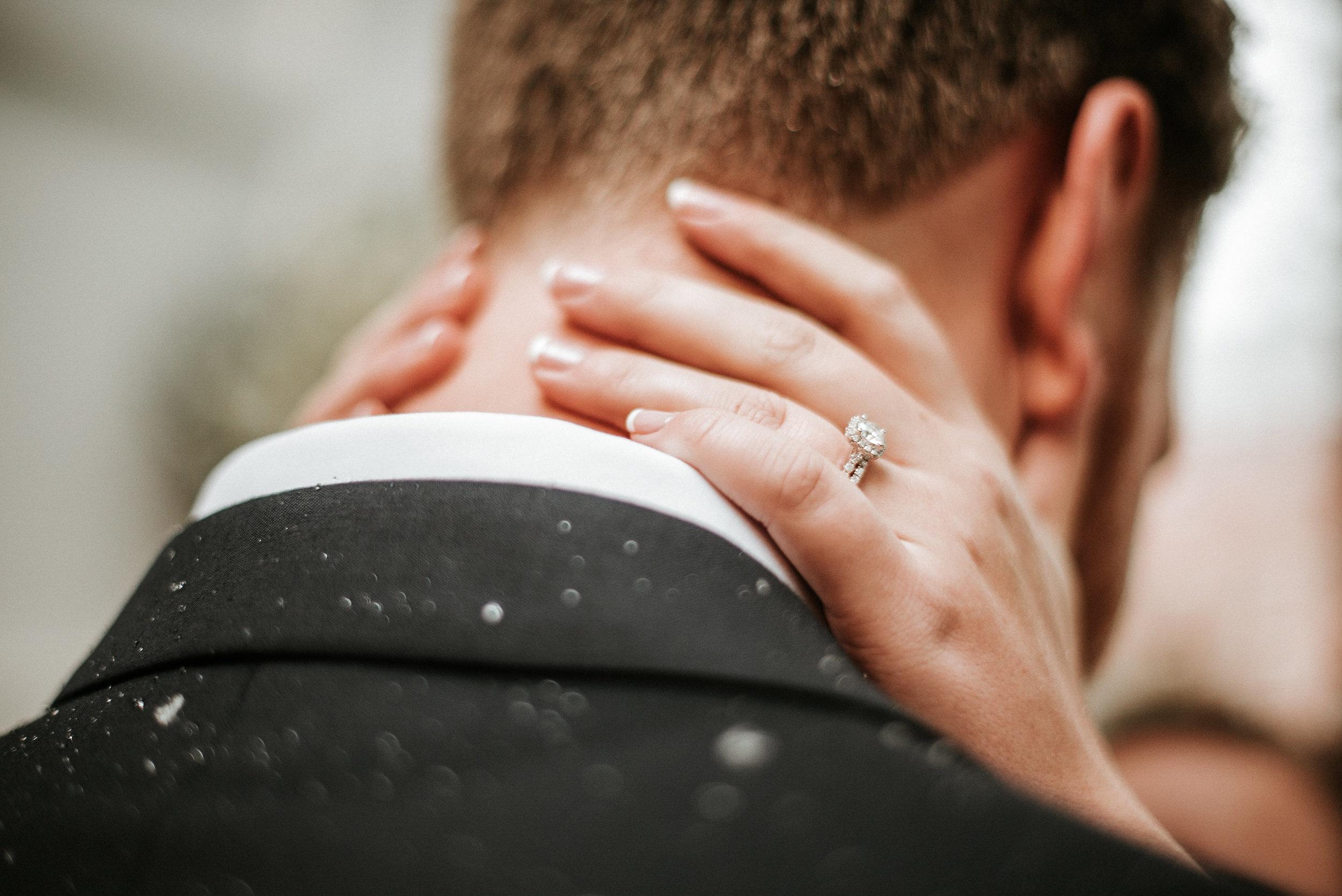 Bride's hands on groom's neck