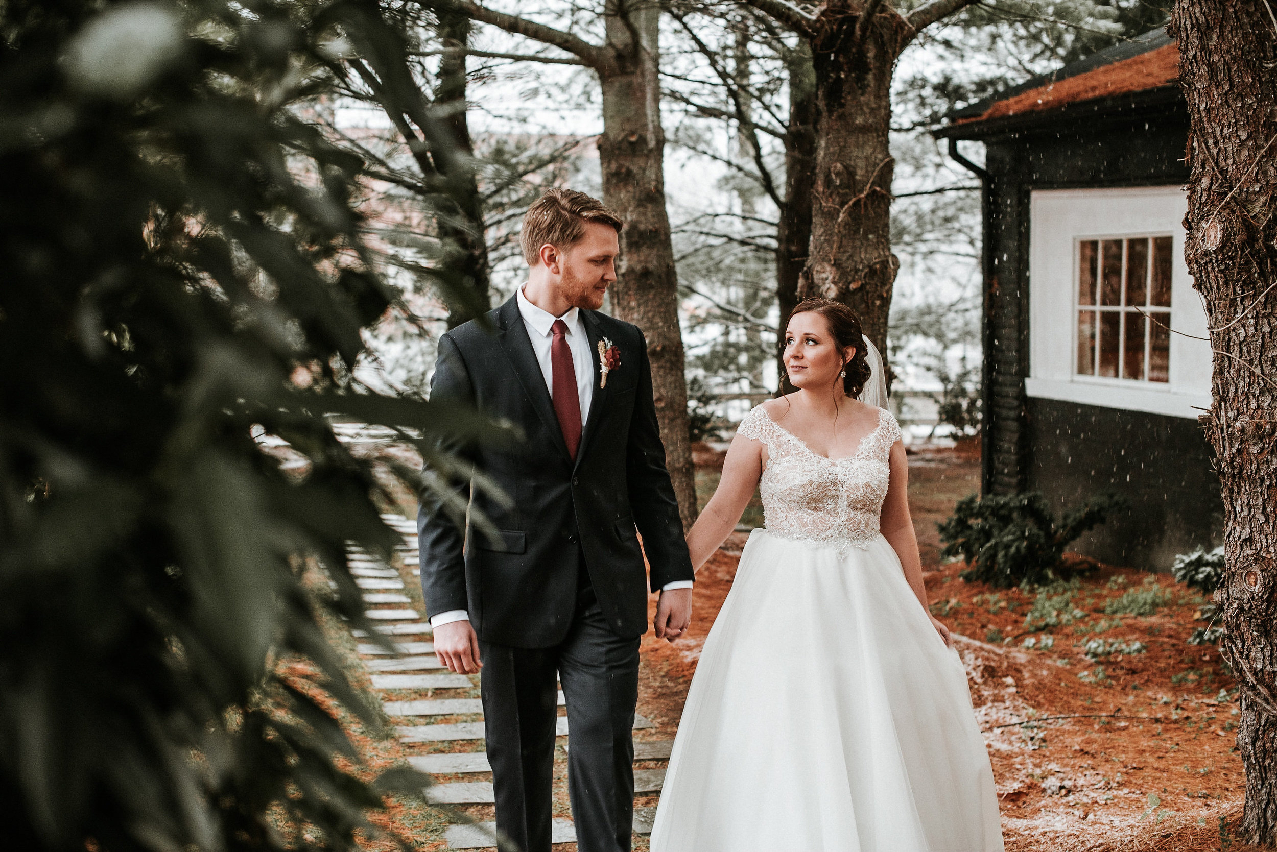 Bride and groom walking on winter path