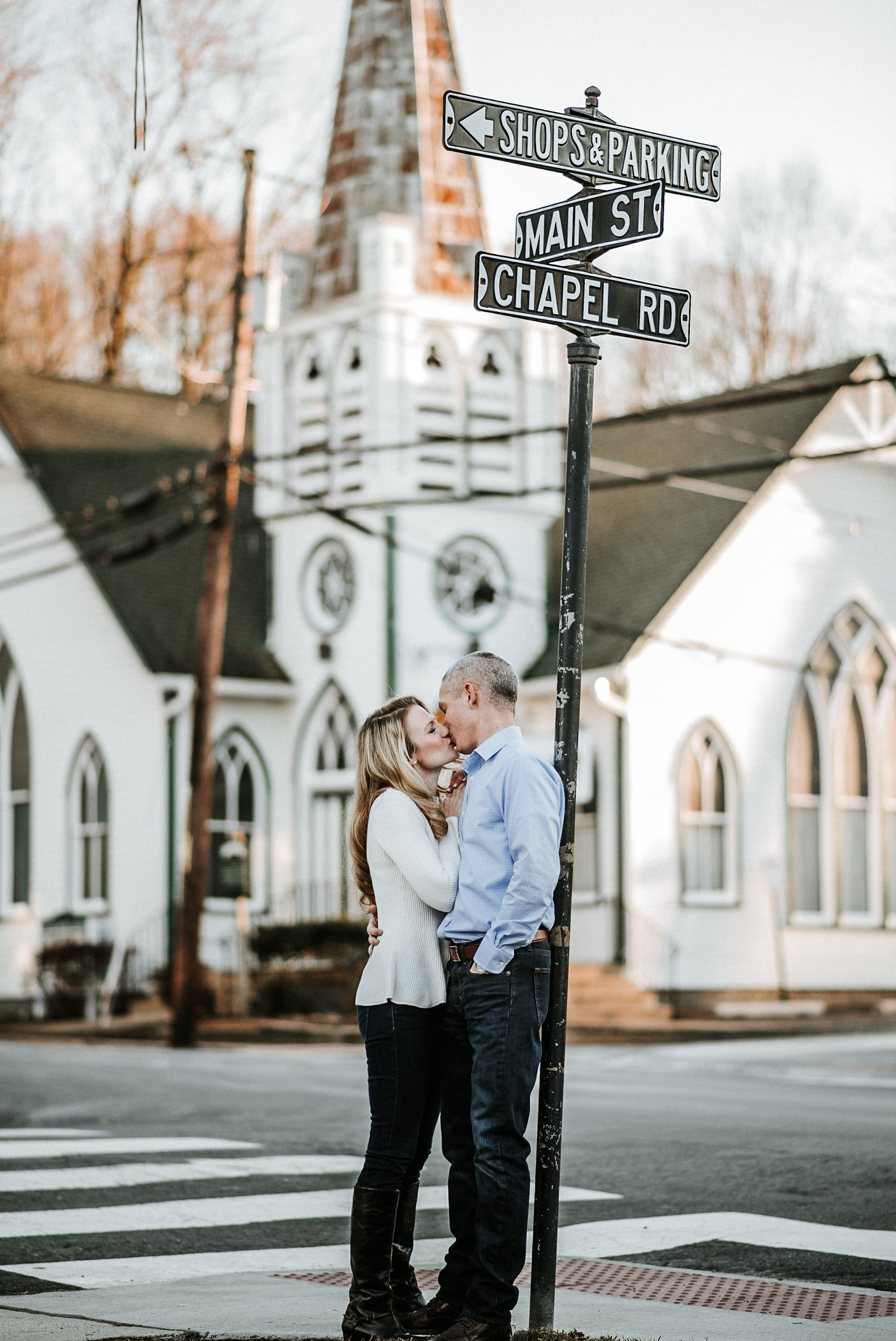 Engaged couple in front of chapel