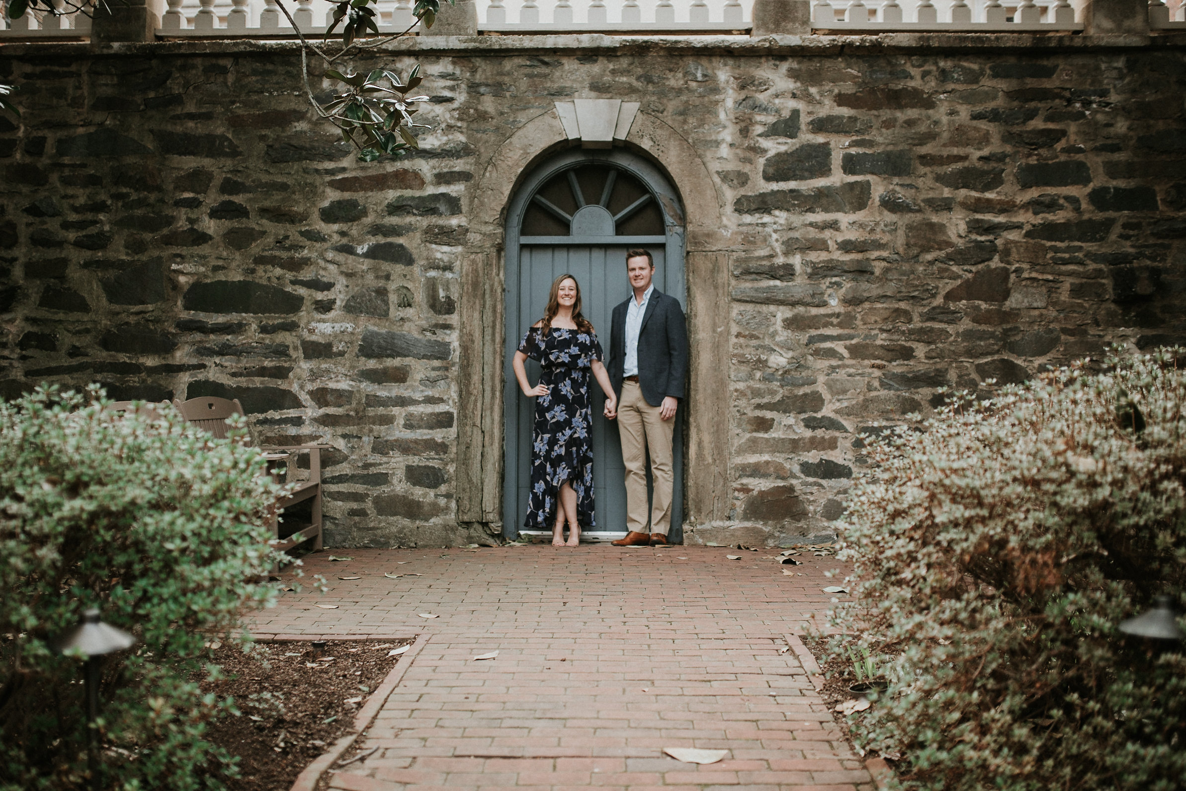 Couple standing in front of doorway