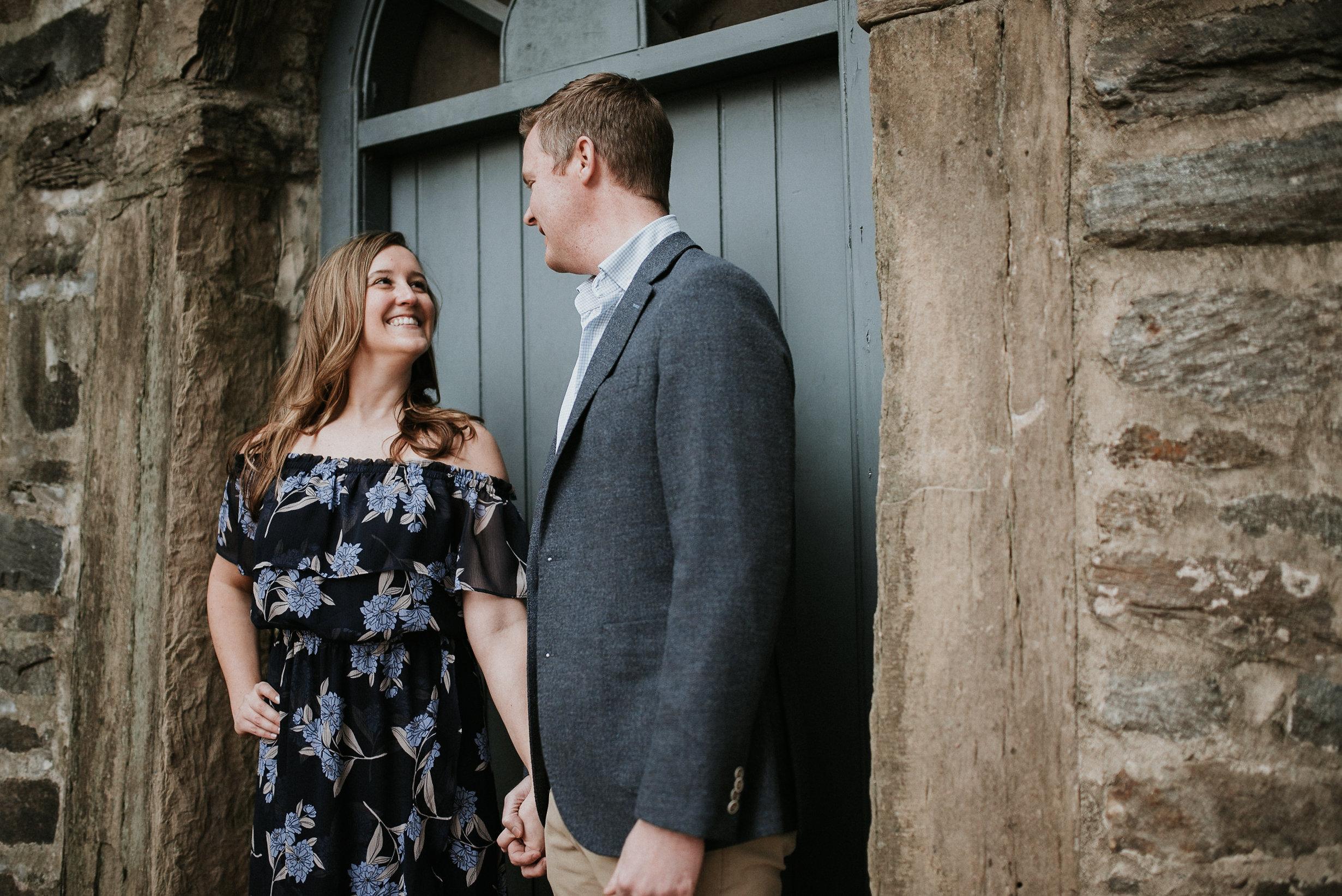 Woman smiling at man in doorway