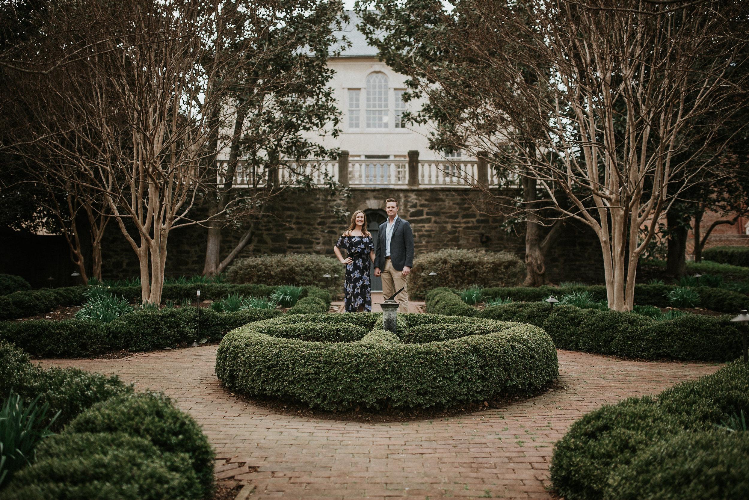 Couple standing in garden