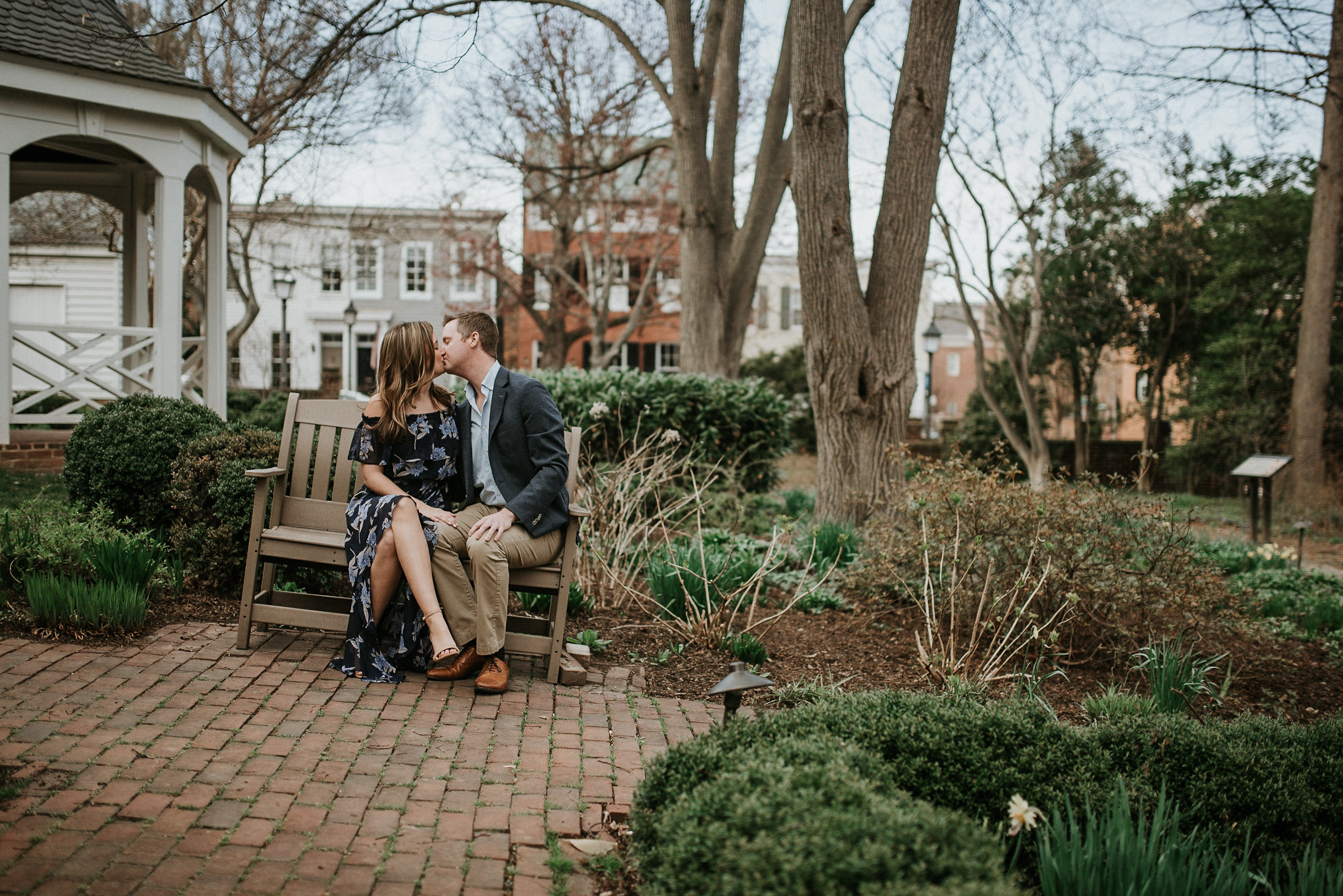 Couple sitting on bench at a slant