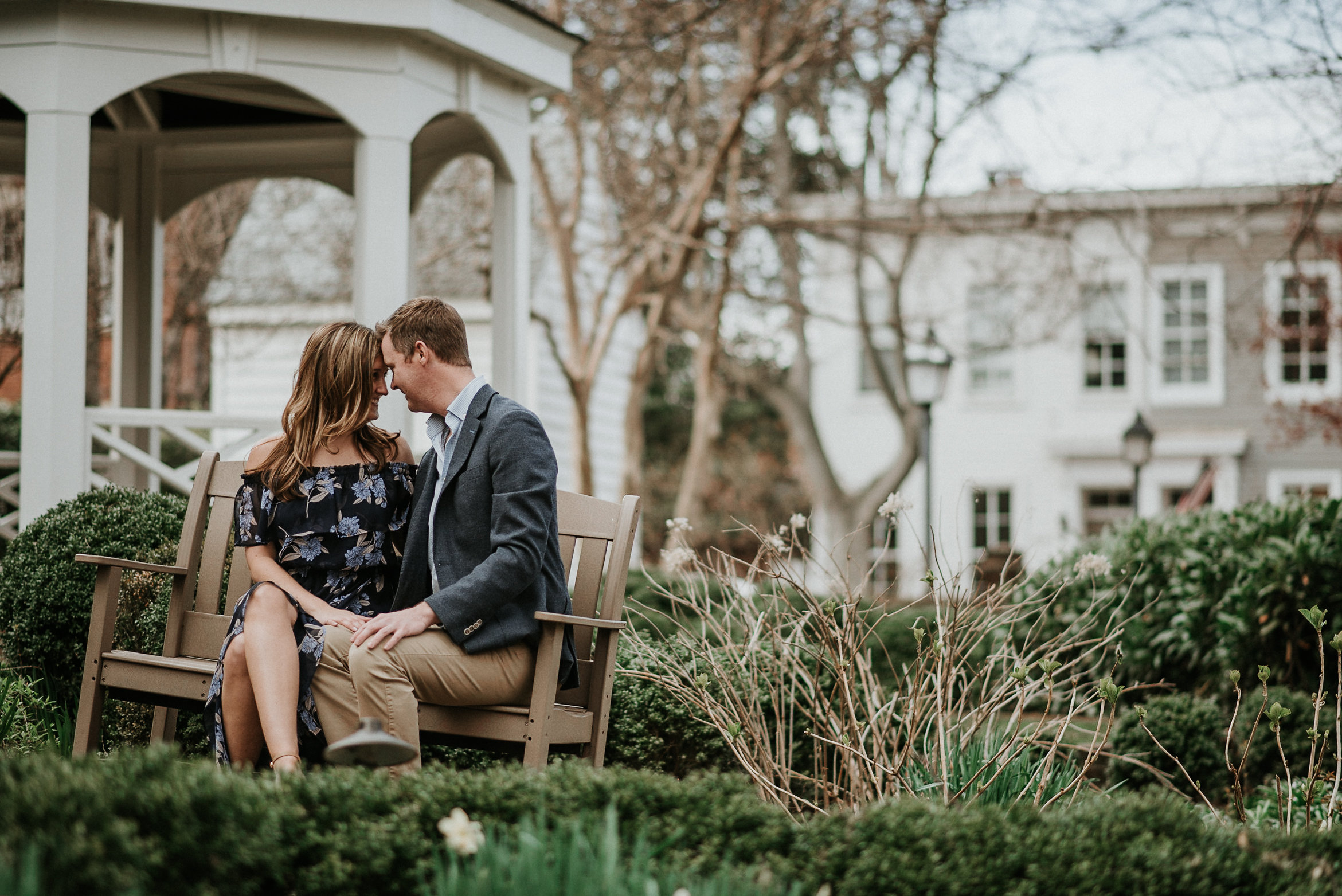 Couple touching foreheads sitting on bench