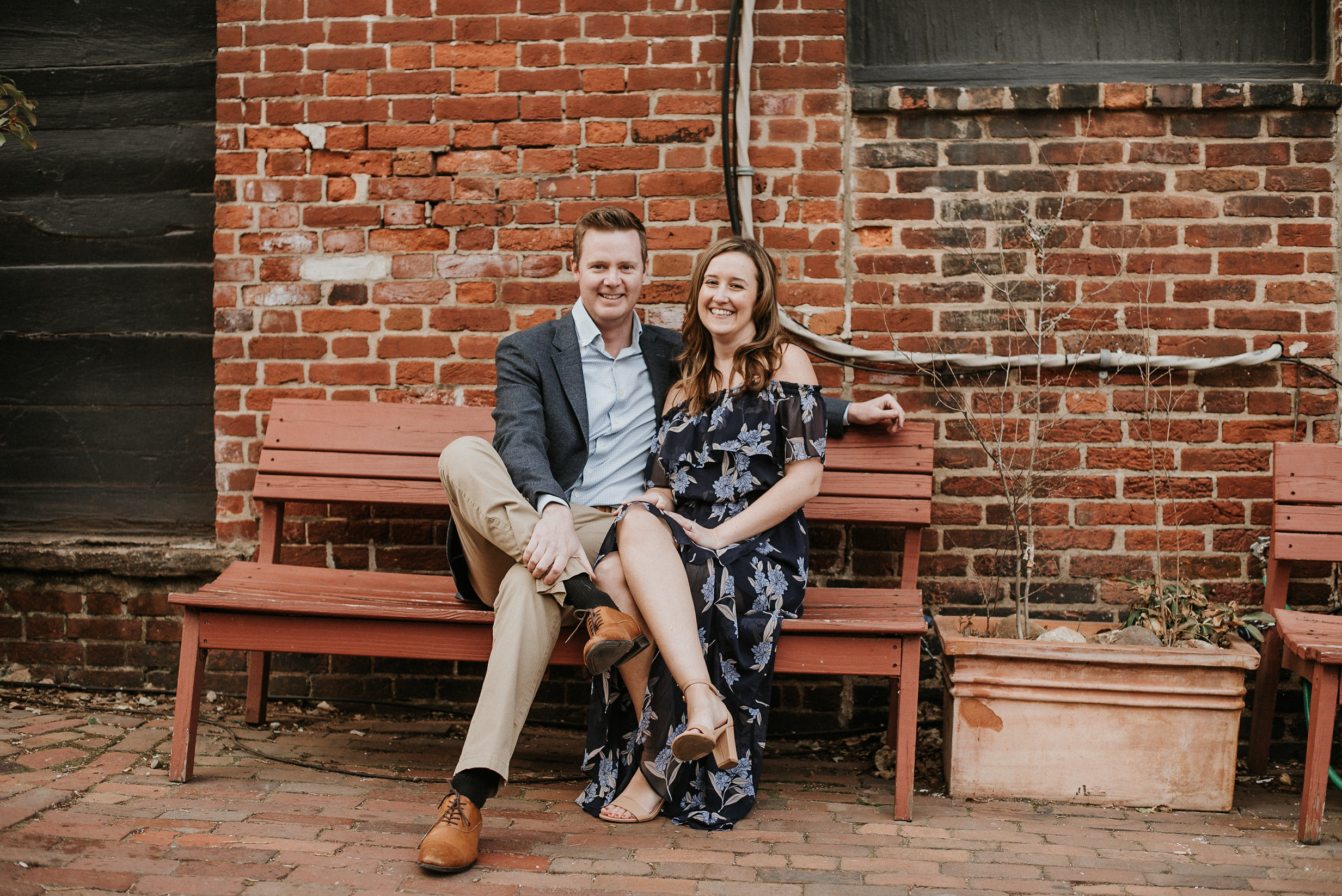 Couple sitting on red bench