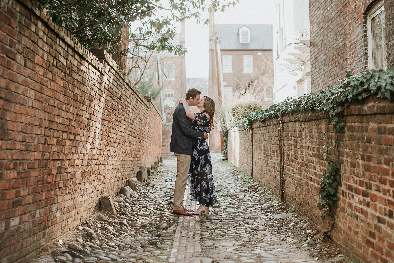 Couple kissing in alleyway