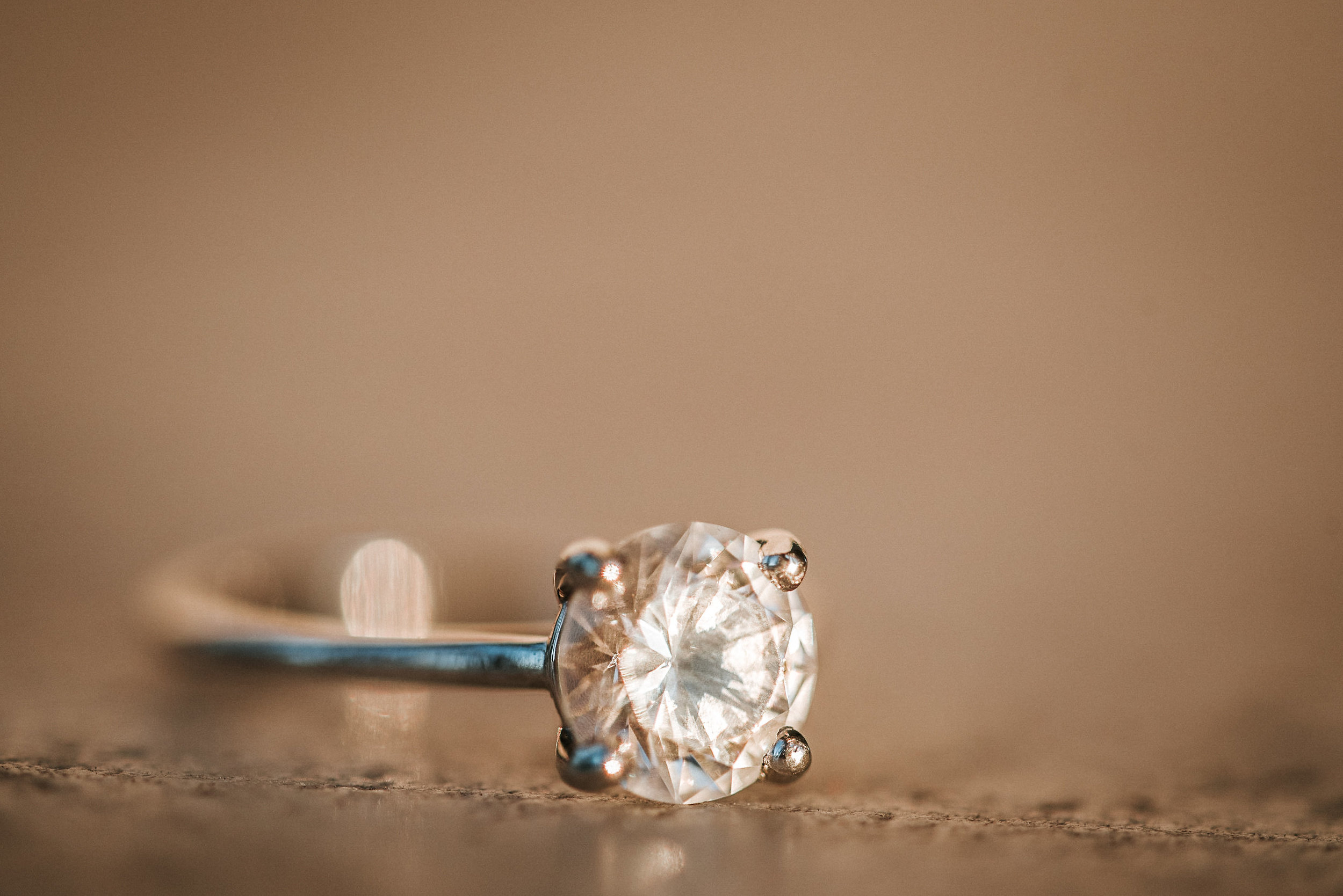 Engagement ring on marble floor