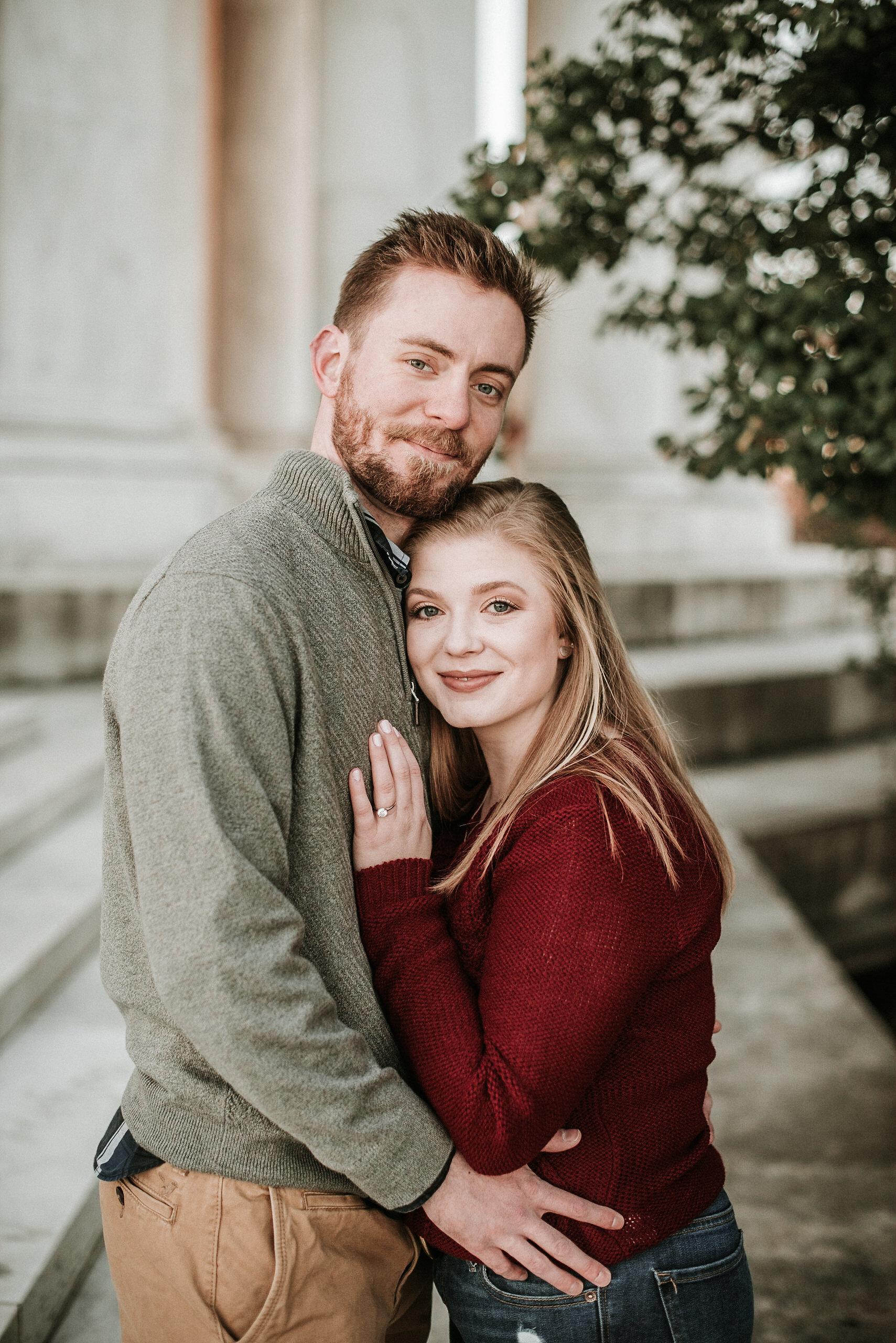 Couple hugging at Jefferson Memorial