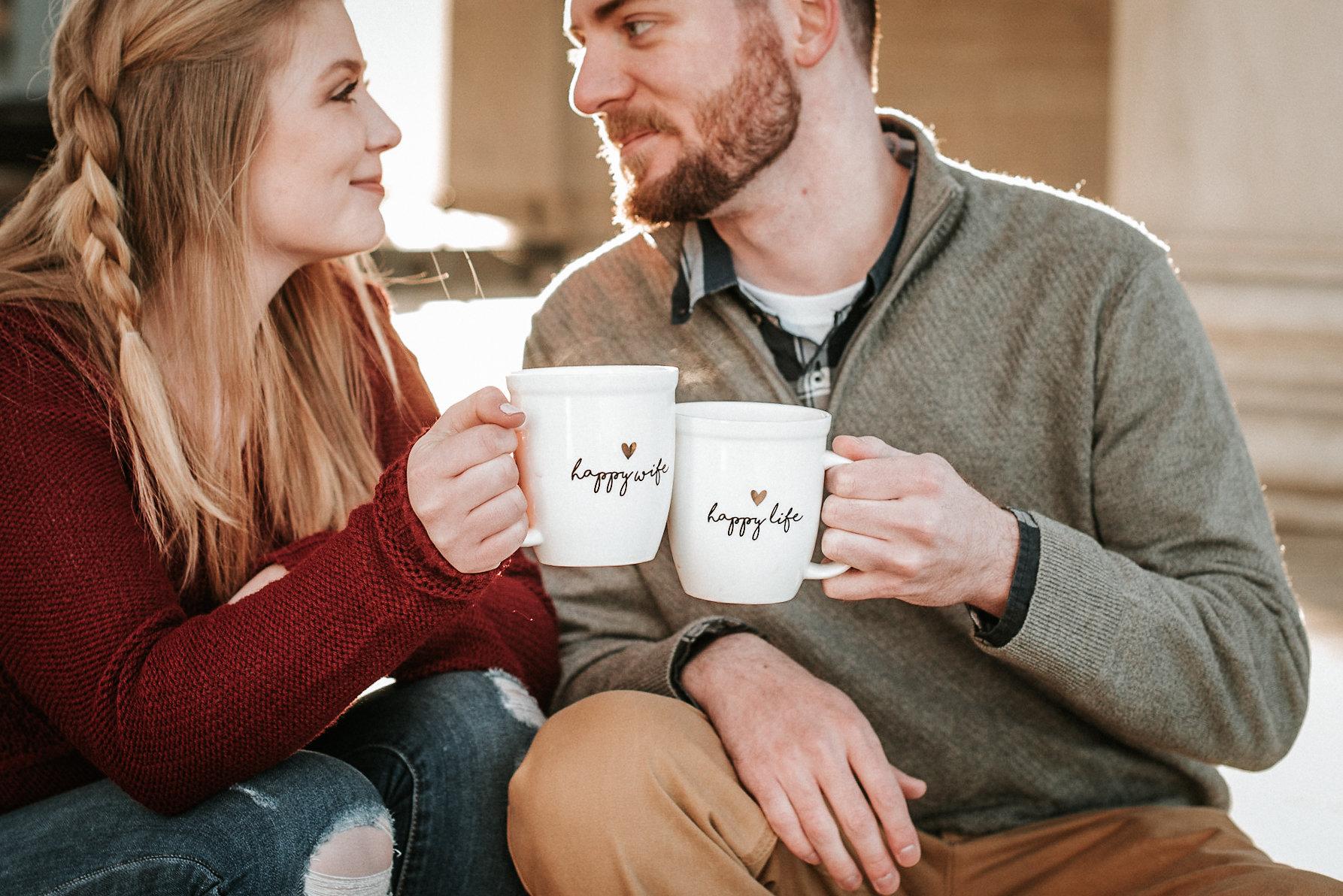 Couple toasting mugs