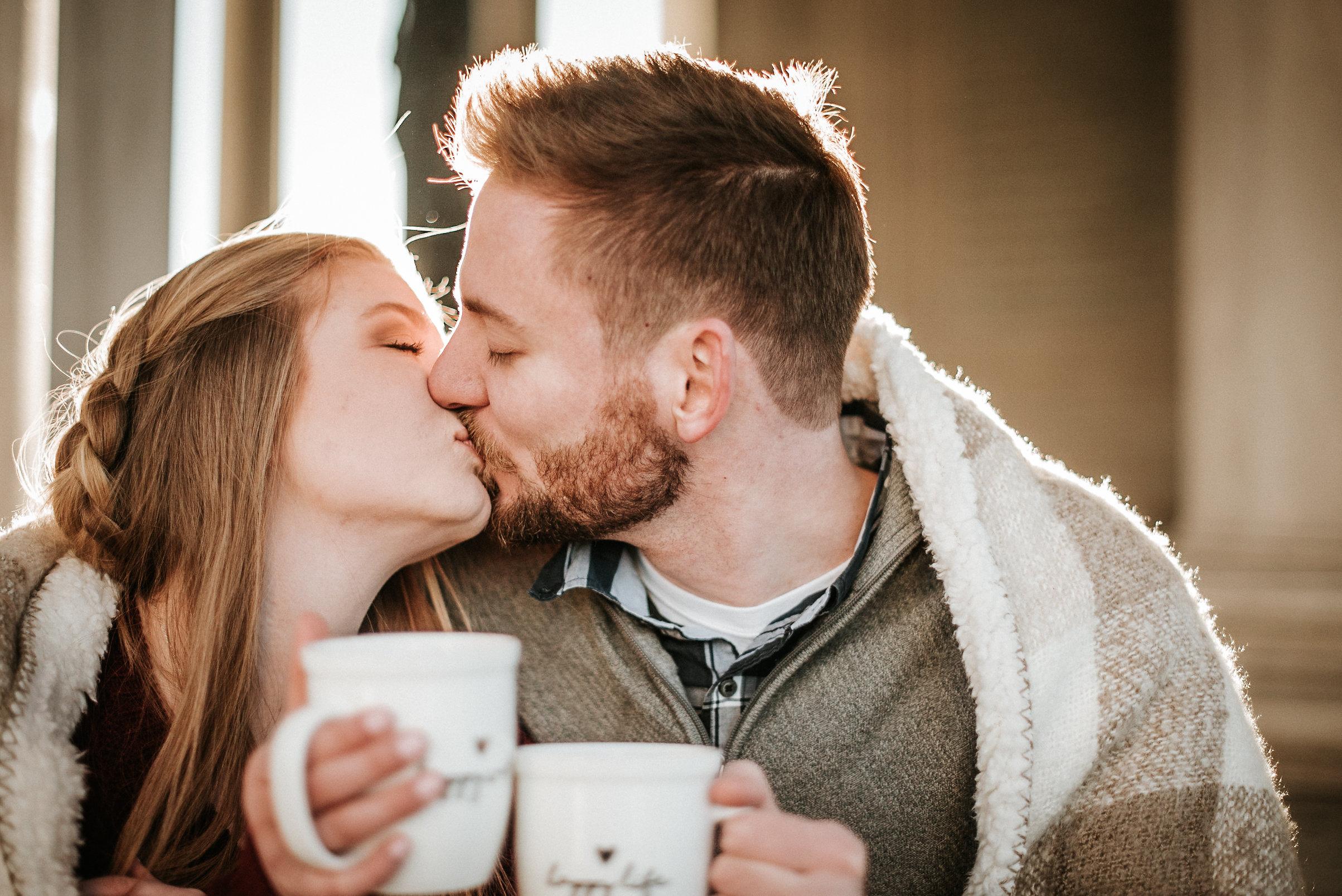 Couple kissing under blanket