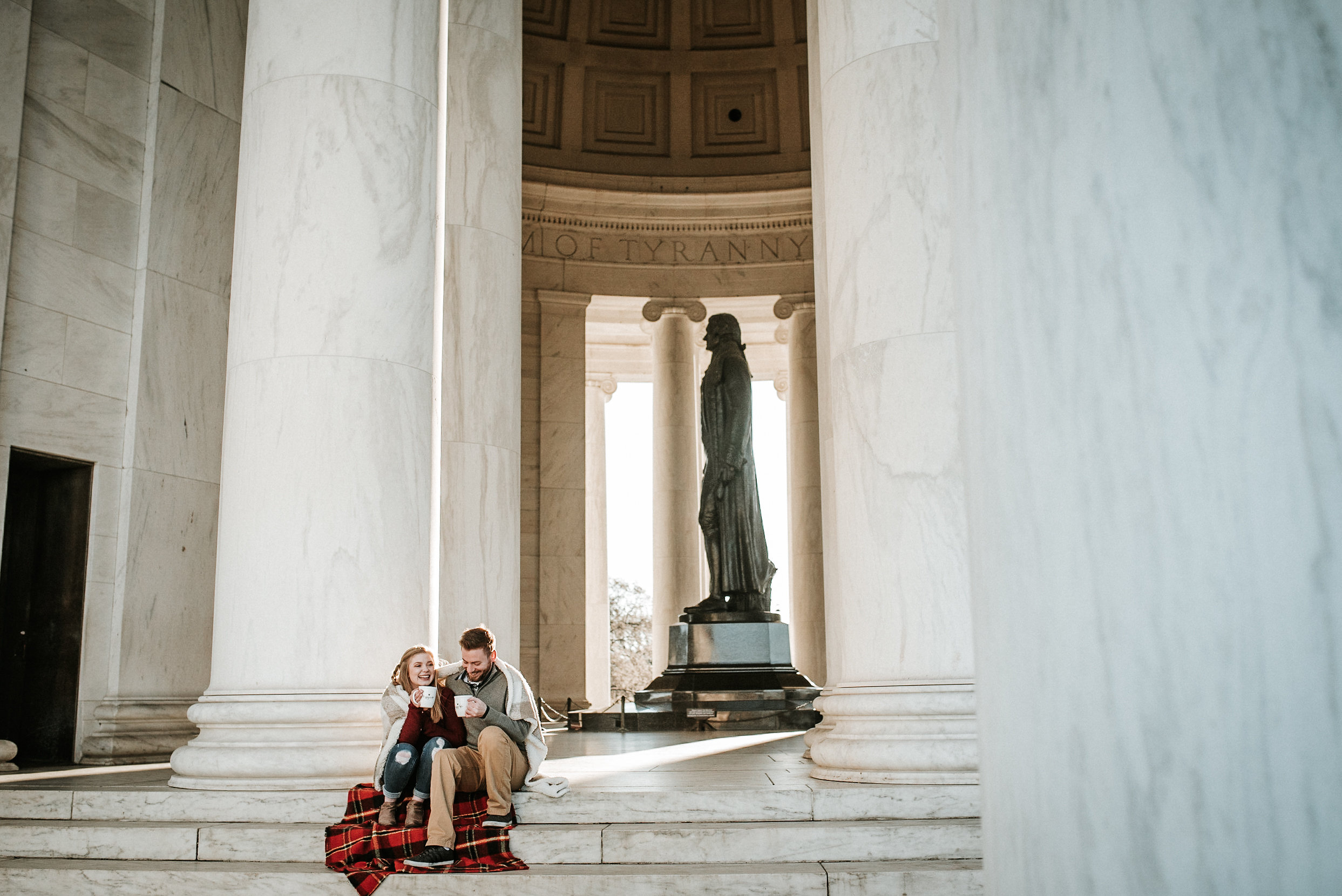 Couple sitting in front of Jefferson Memorial