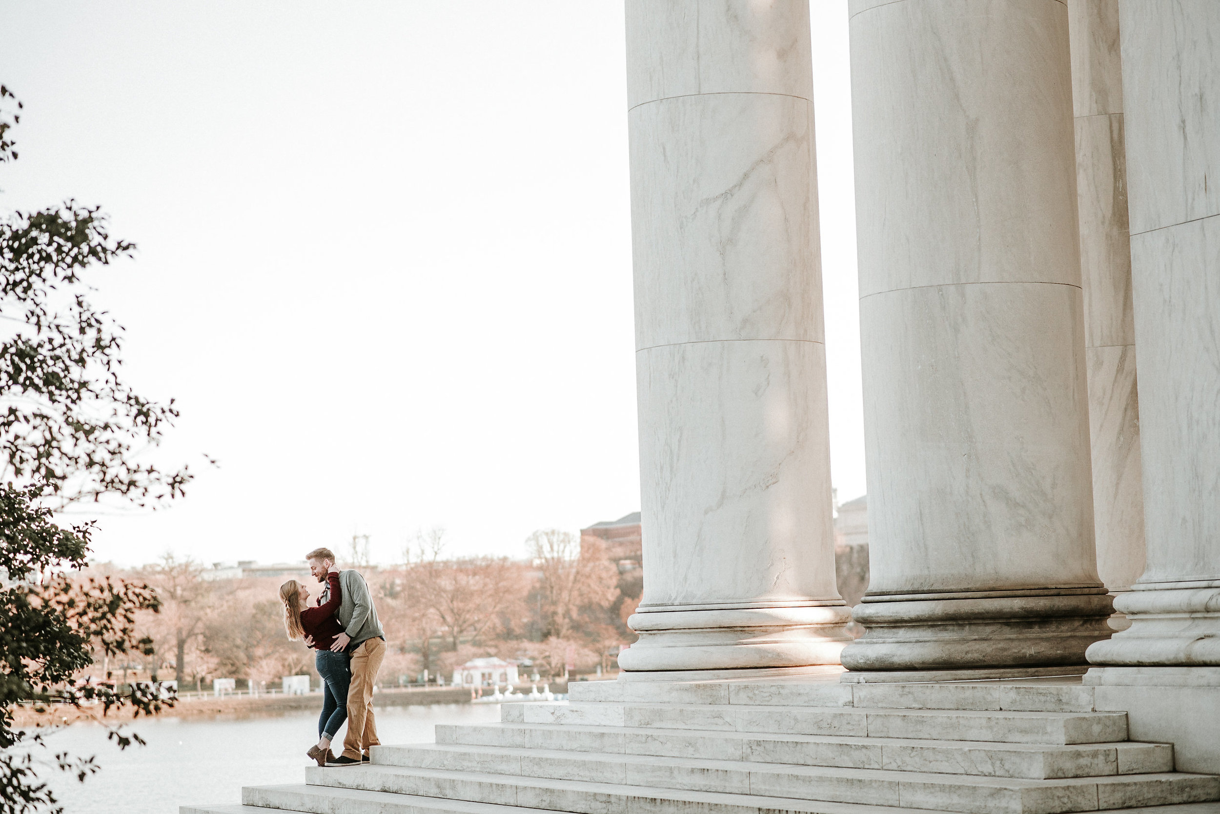 Couple embracing on monument steps