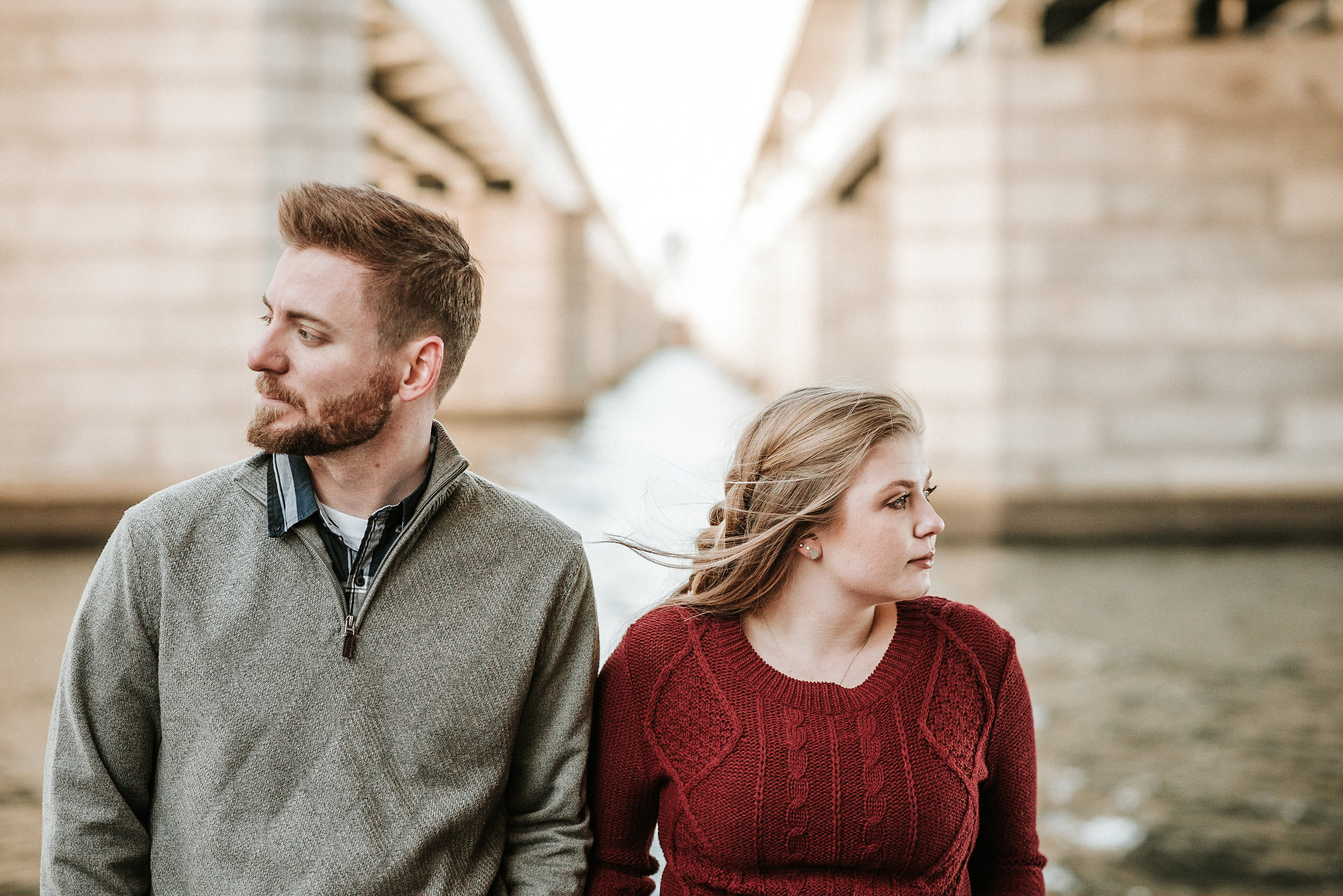 Couple looking away from one another at river