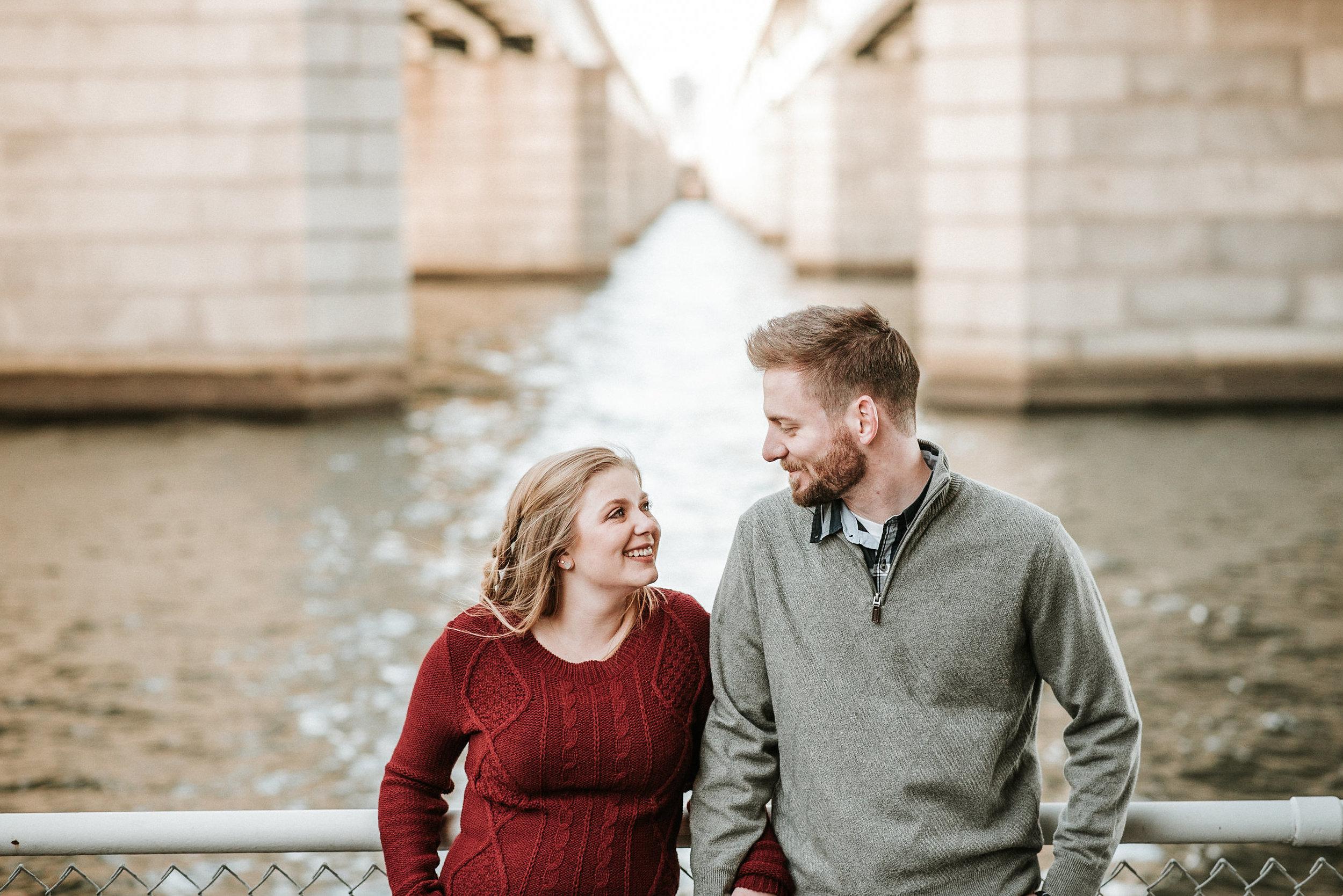 Couple standing under bridge