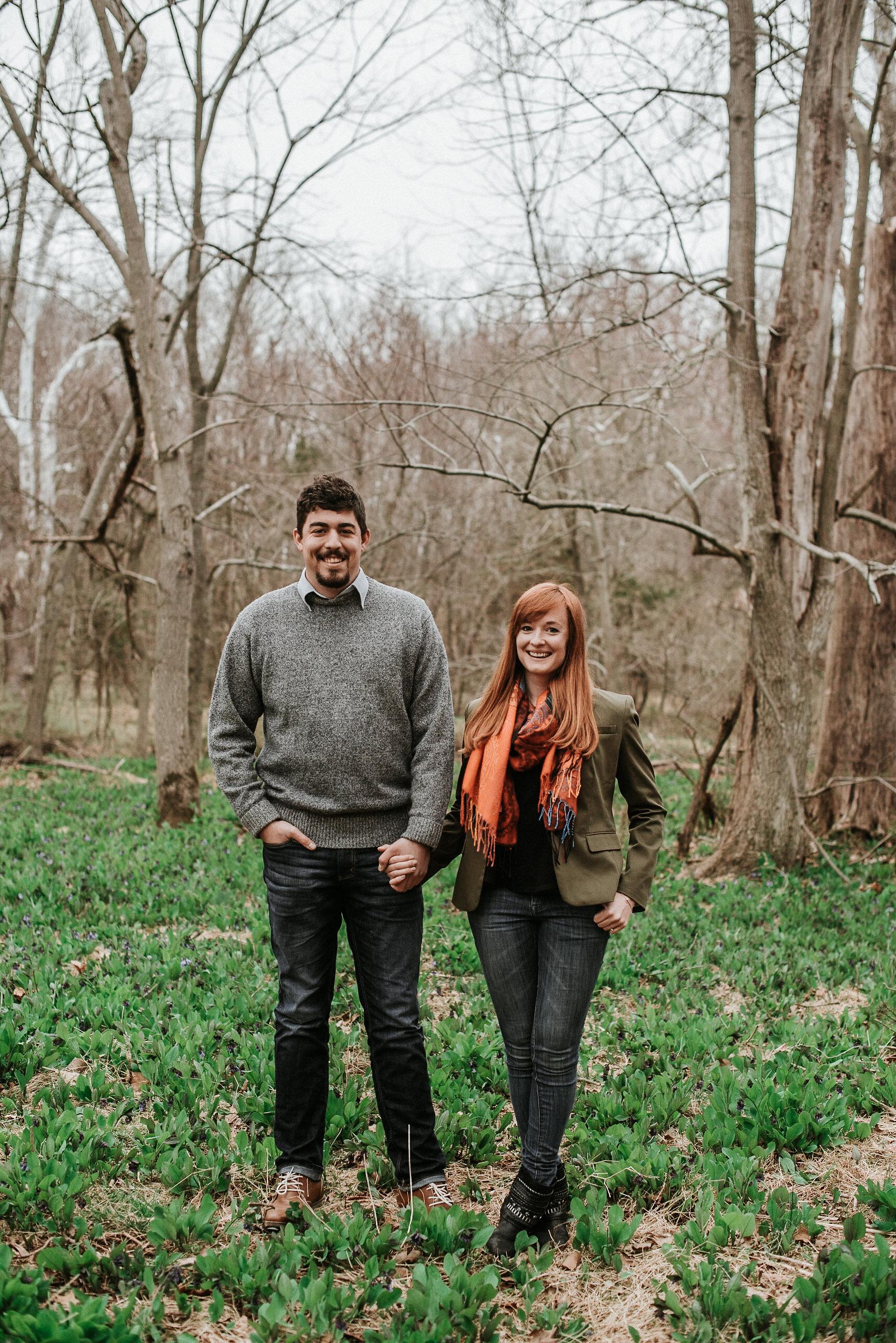 Couple standing together among trees