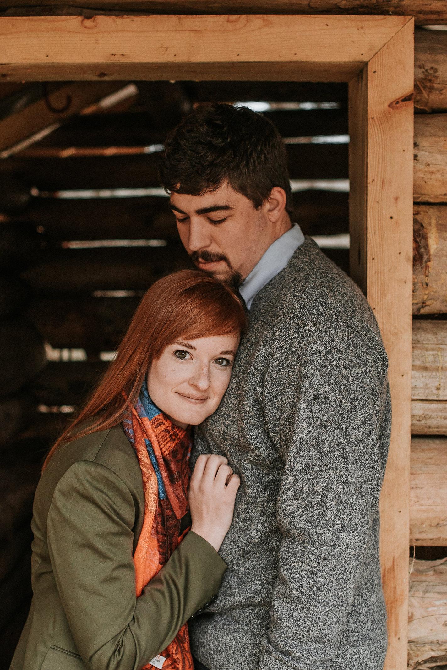 Woman and man standing in cabin doorway