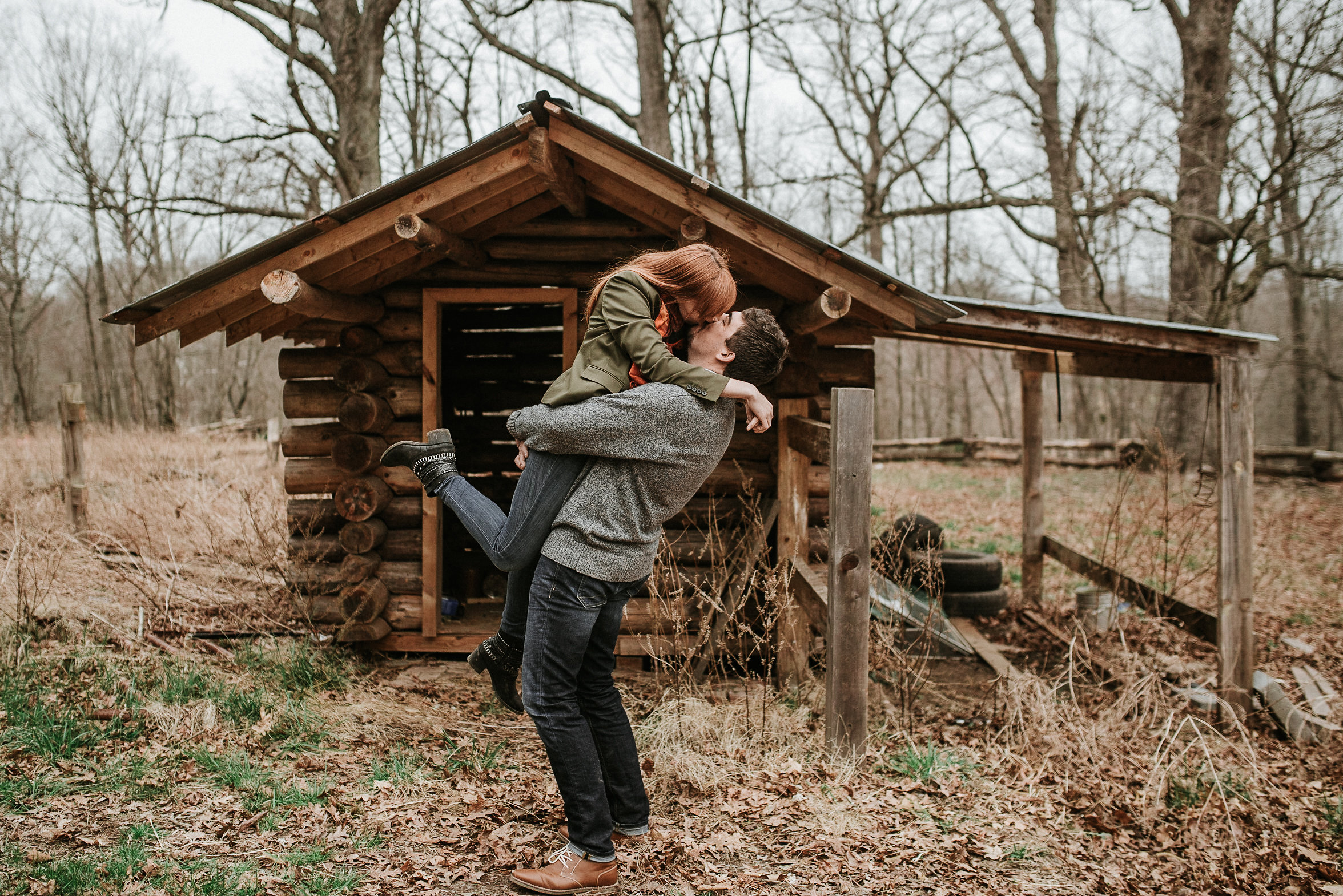 Couple kissing in front of cabin