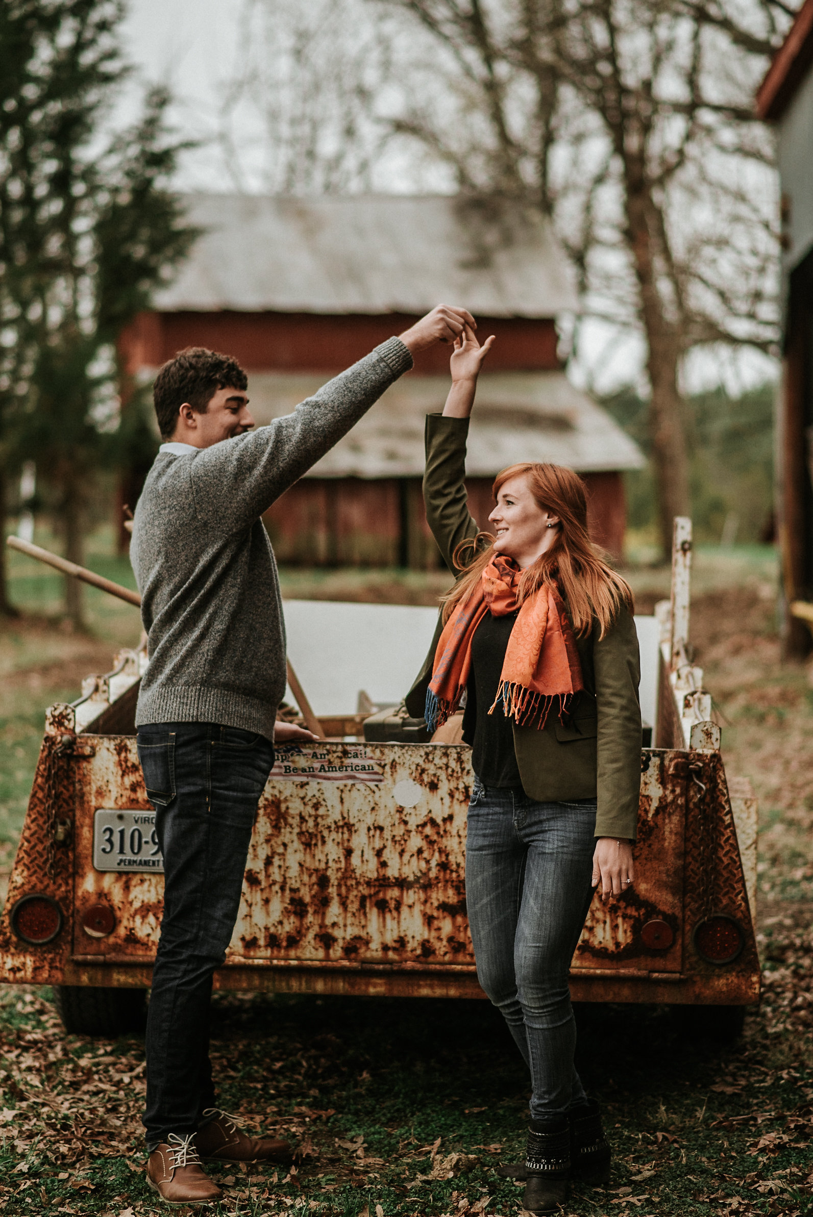 Couple dancing in front of old truck