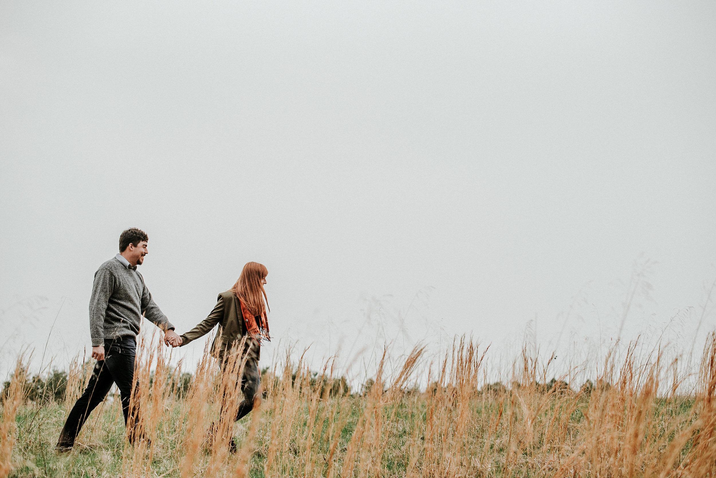 Woman leading man across field
