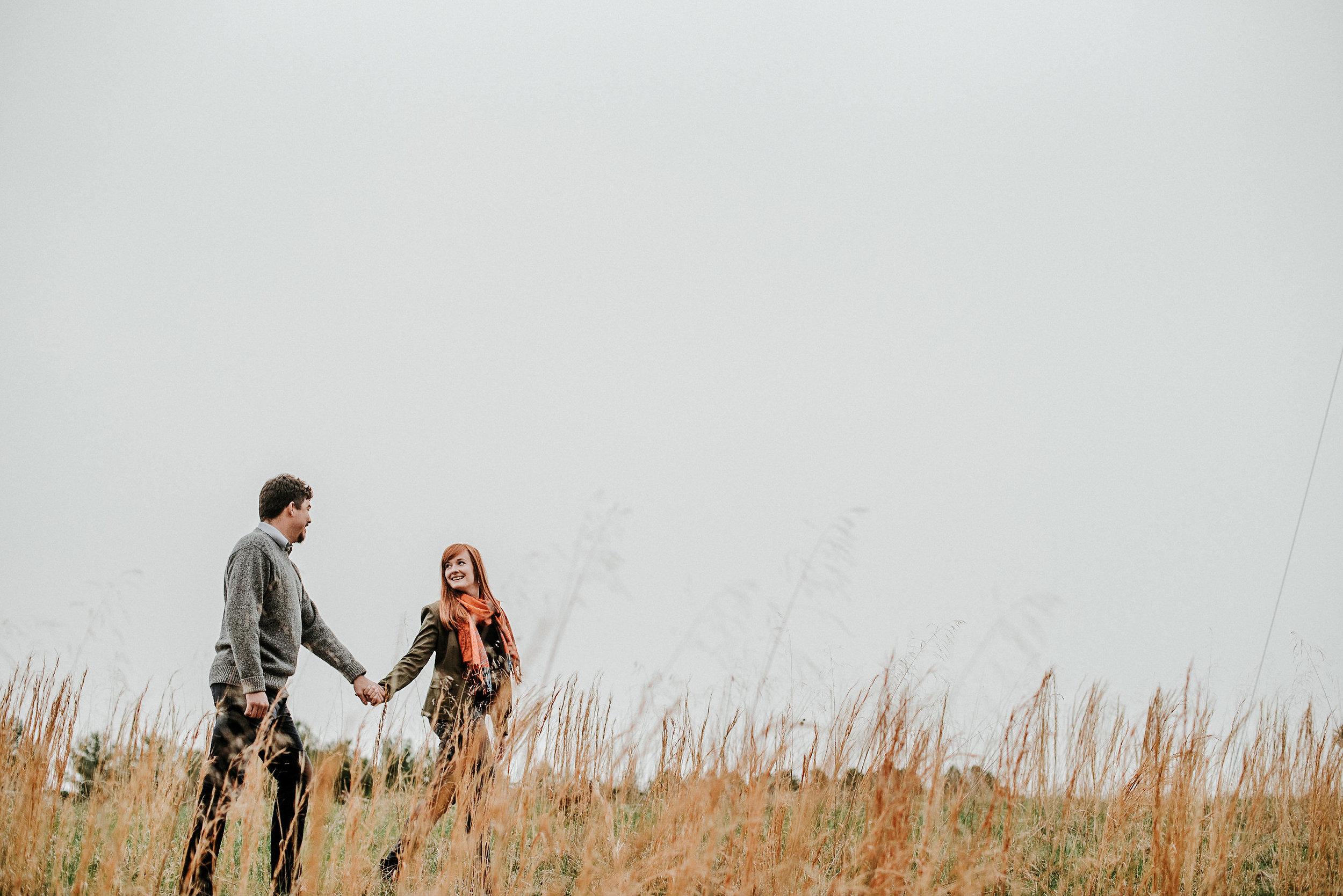 Couple walking across field
