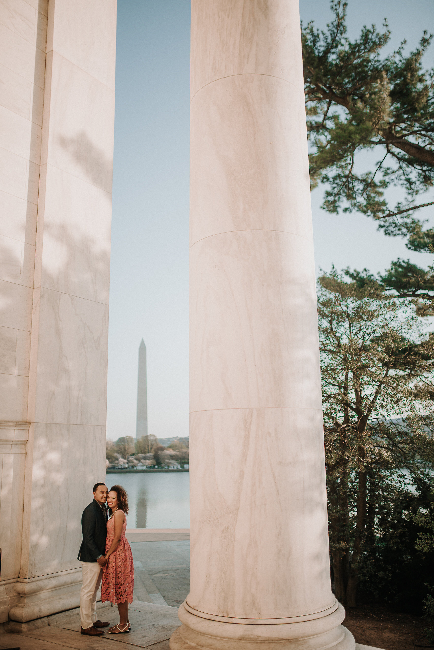 Couple posing by column at monument