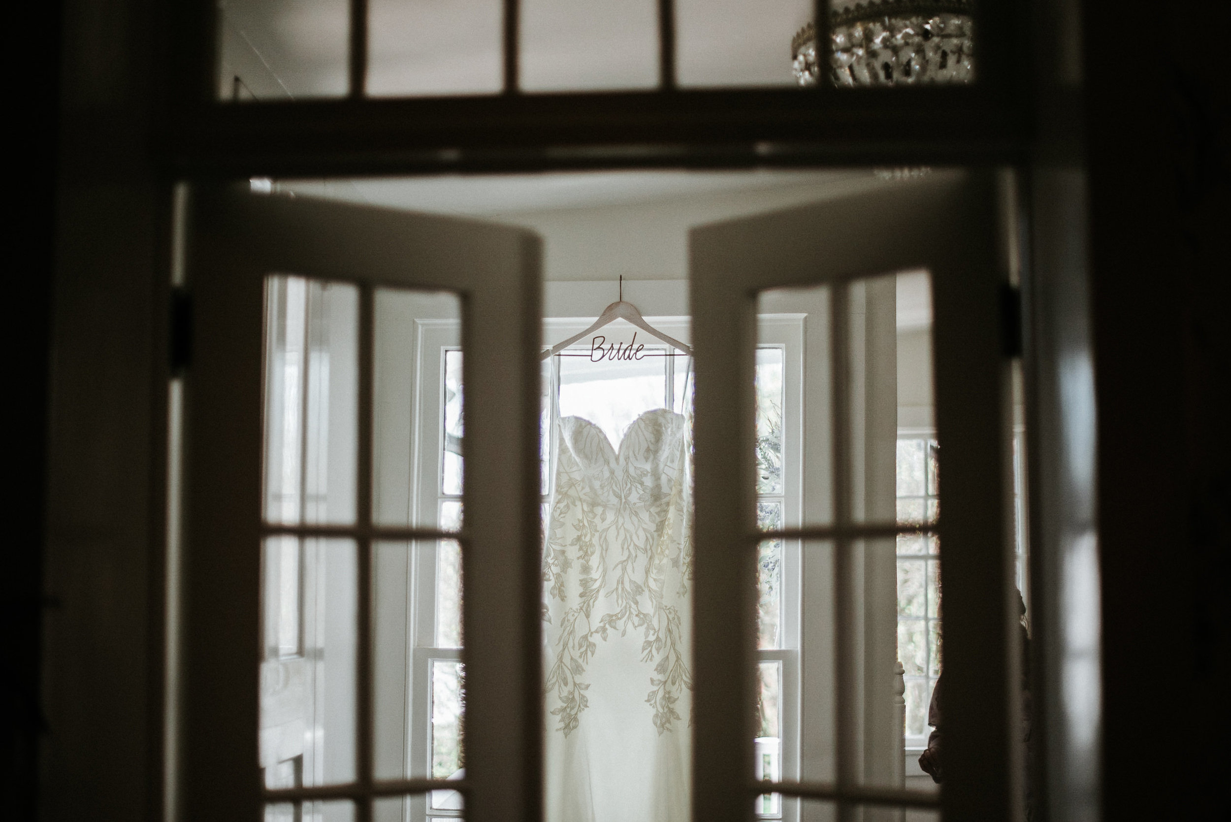 Wedding dress seen through doors