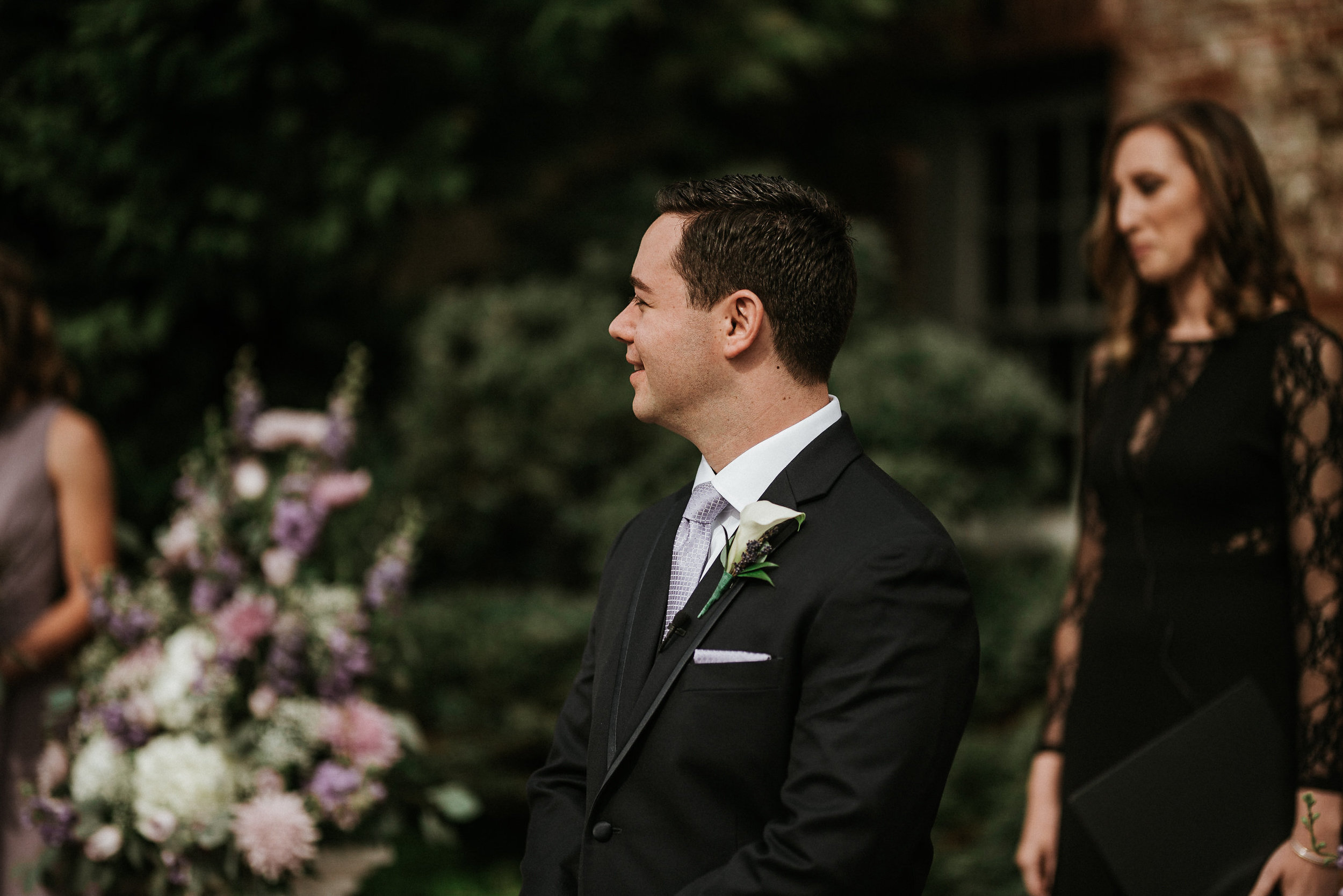 Groom standing at front of aisle during ceremony