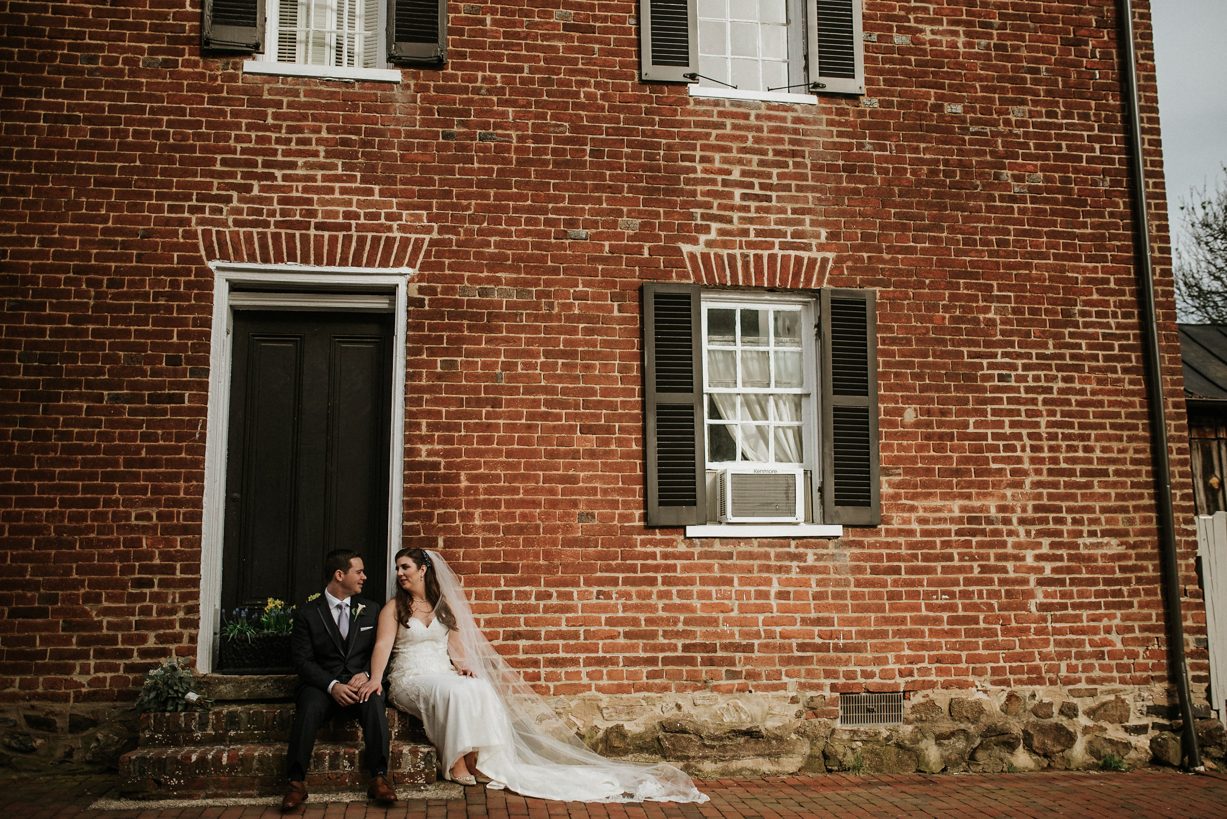 Bride and groom sitting on stoop