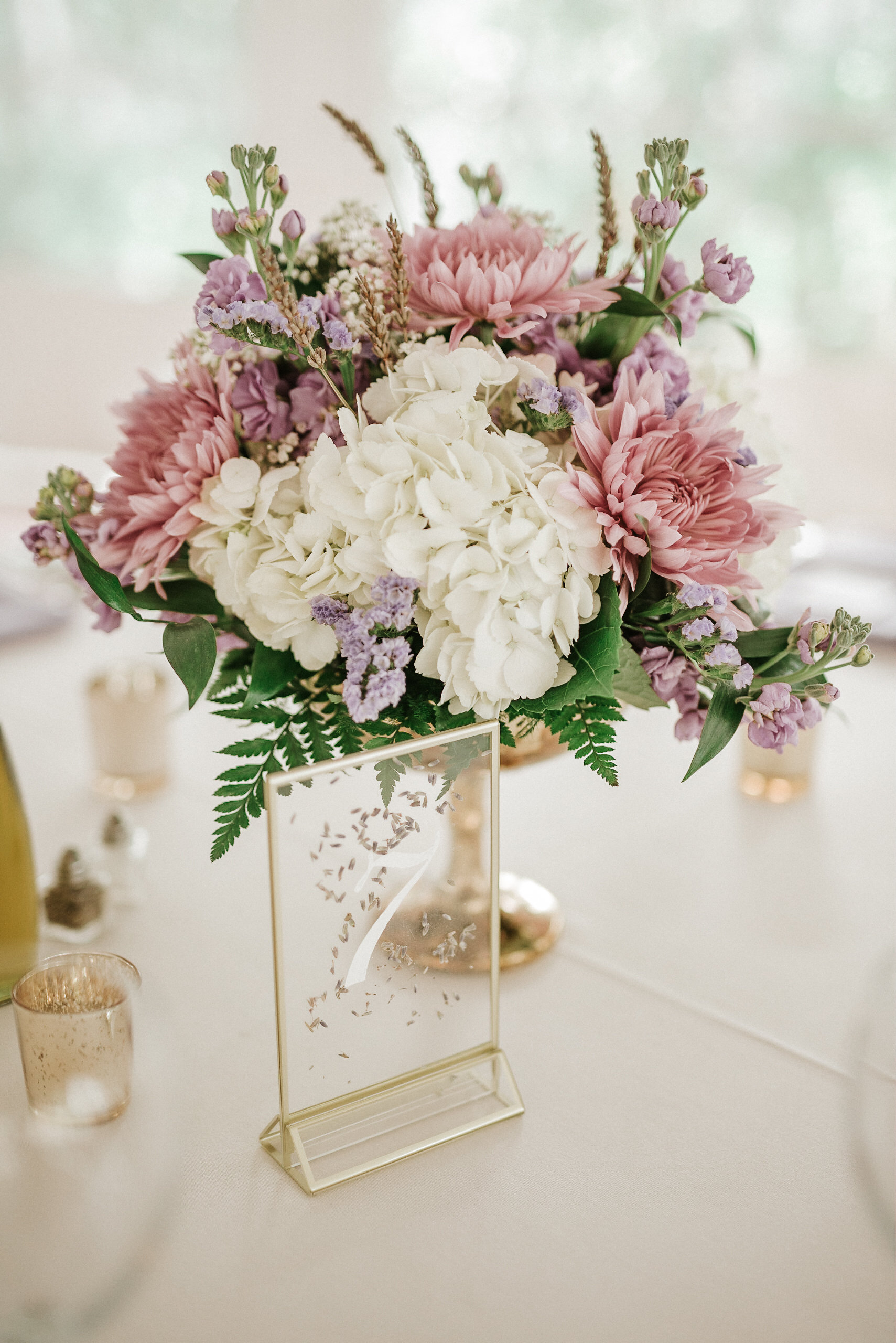 Flower arrangement at spring wedding reception