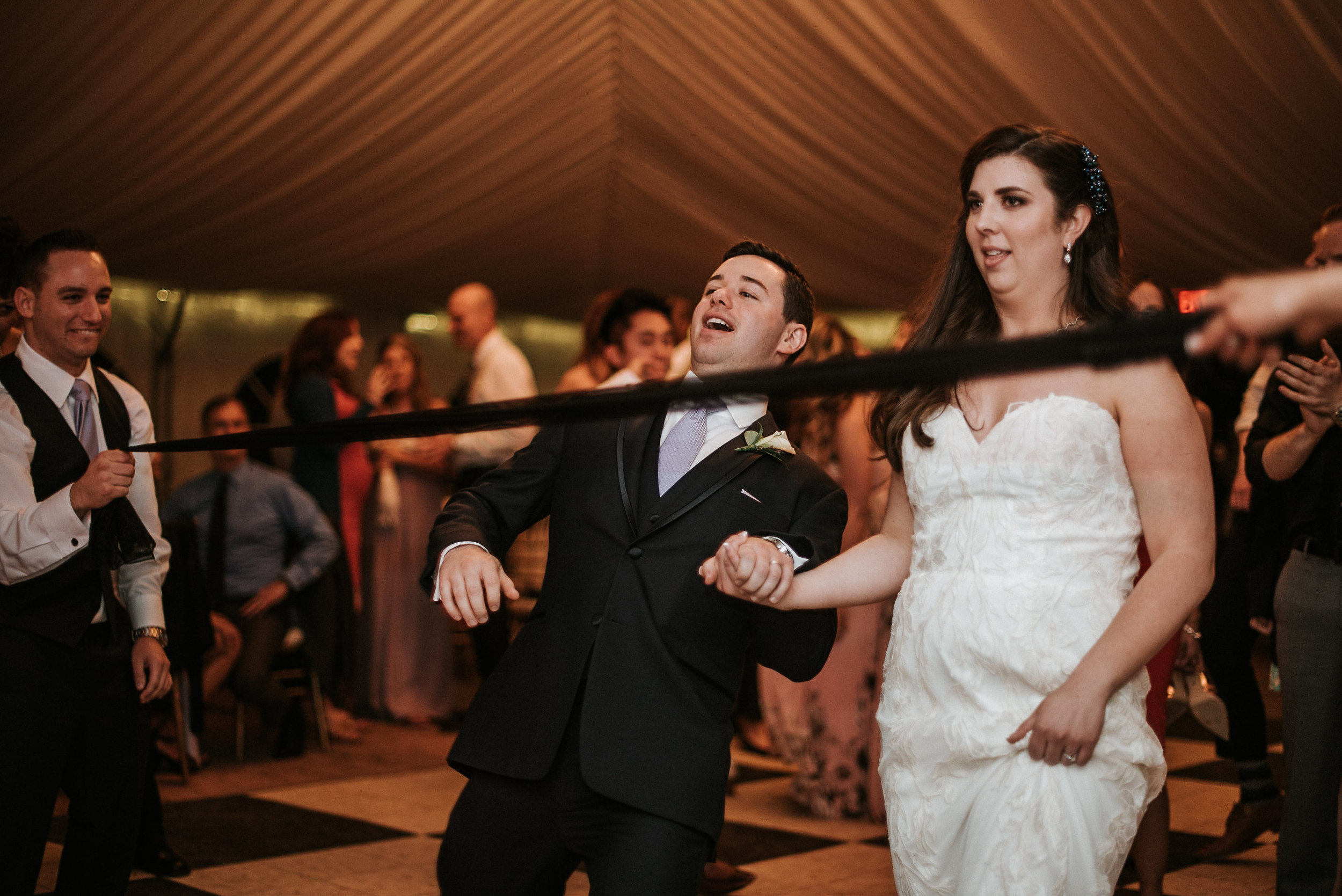 Bride and groom doing the limbo