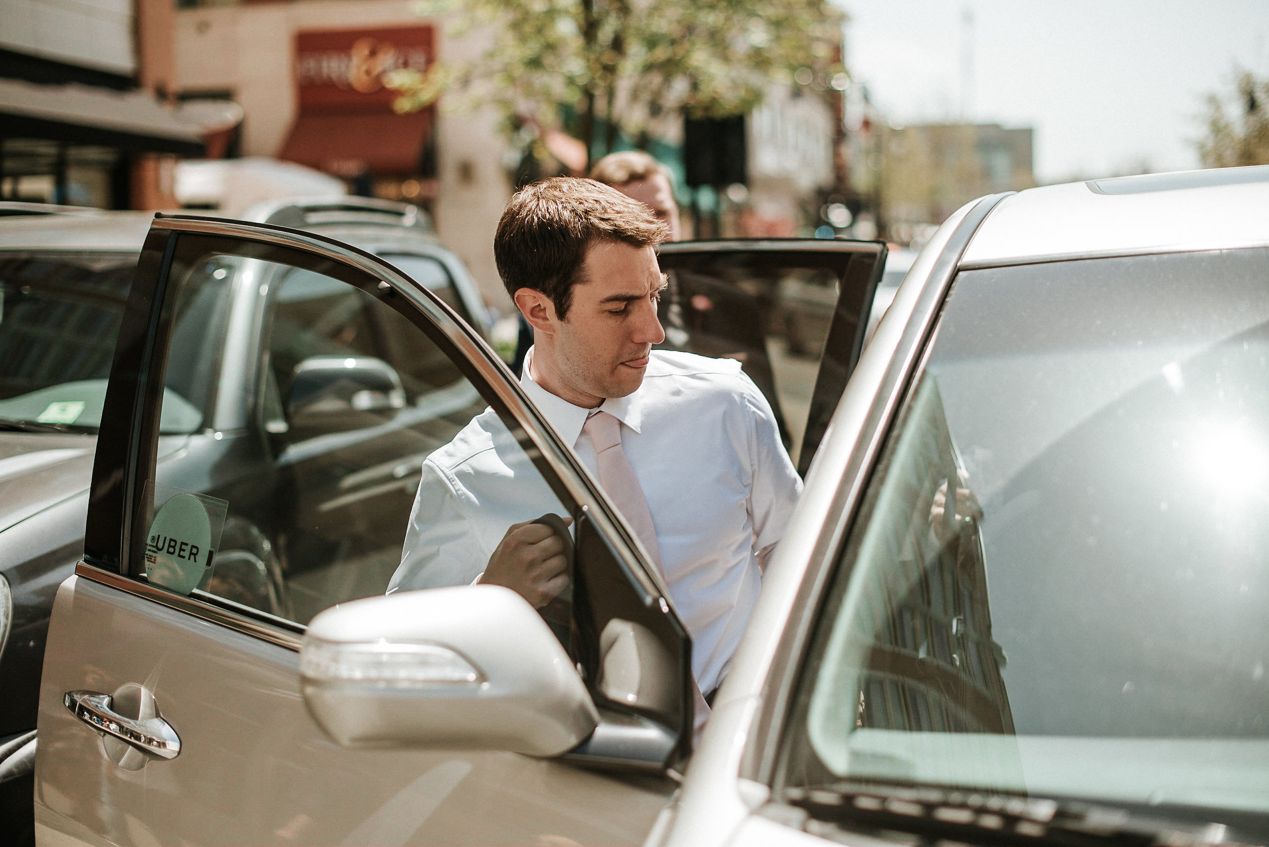 Groom climbing into car